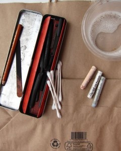 Cheap Supplies: Tin of charcoal, Q-tips, 3 pastels for painting light, tub of bleach.