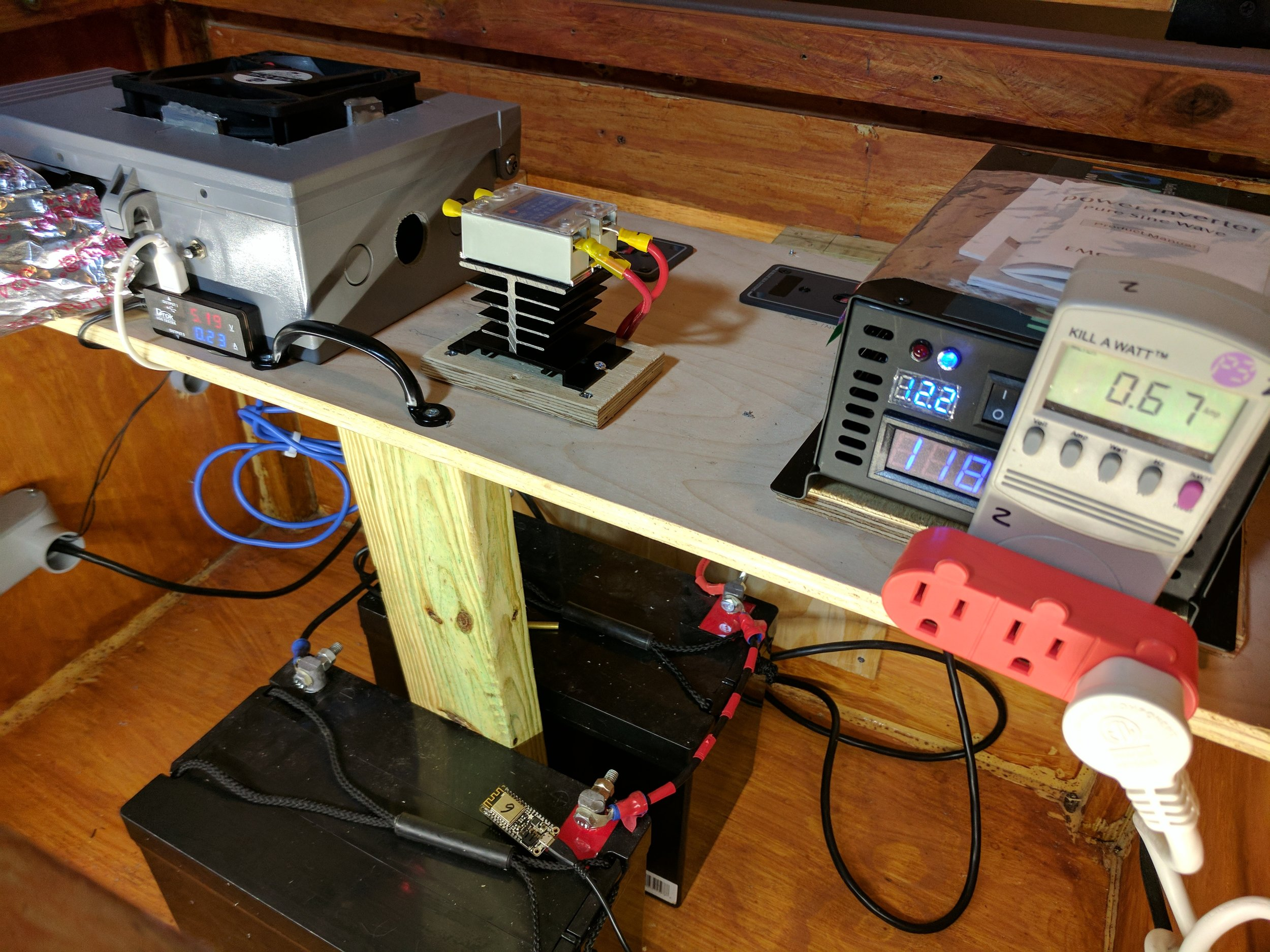 Close up of the batteries, DC to AC inverter, and solid state relay that controls power to the inverter.