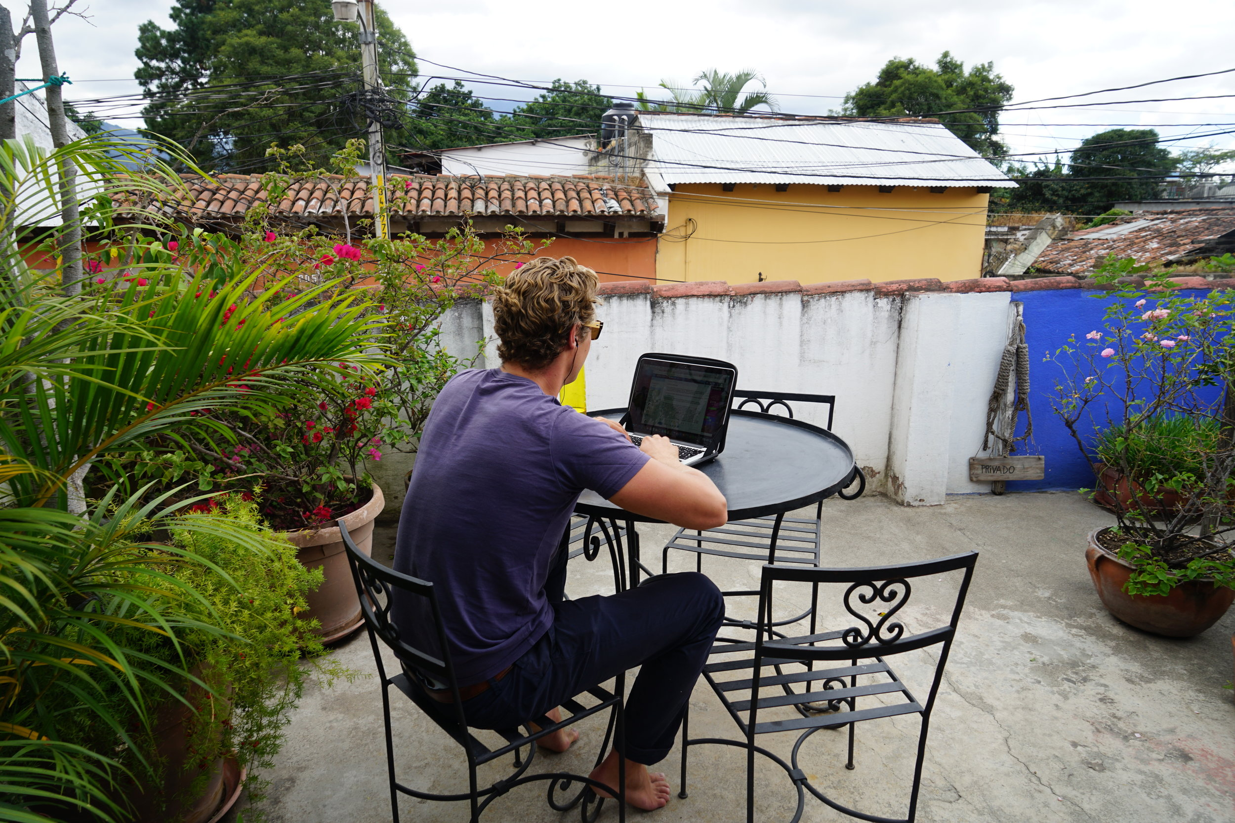 MacroAdventure Co-Founder Dom writing this blog post at our hostel in Antigua City, Guatemala