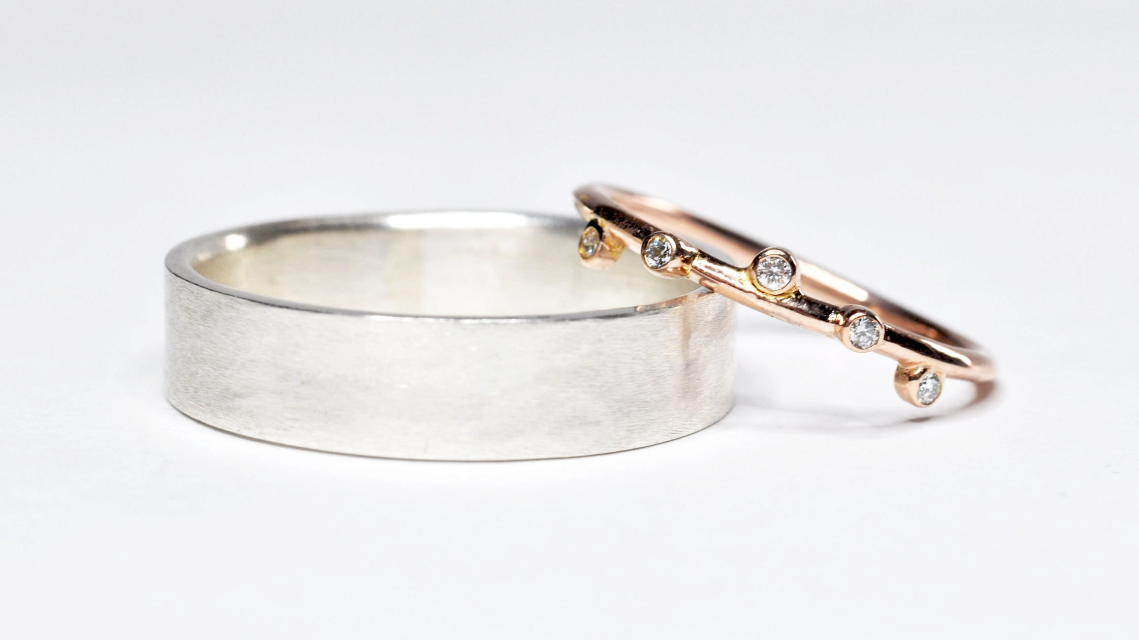 Pictured is a previous bespoke order I was honored to be asked to design and create - a sterling silver band for him and a 14k rose gold with diamonds for her.