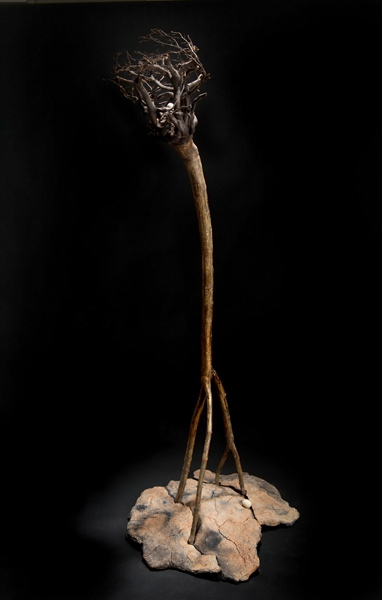 """Eco-Icon   2005    clay, kiln- and pit-fired, found tree trunk    c. 60""""h. x 24""""w."""
