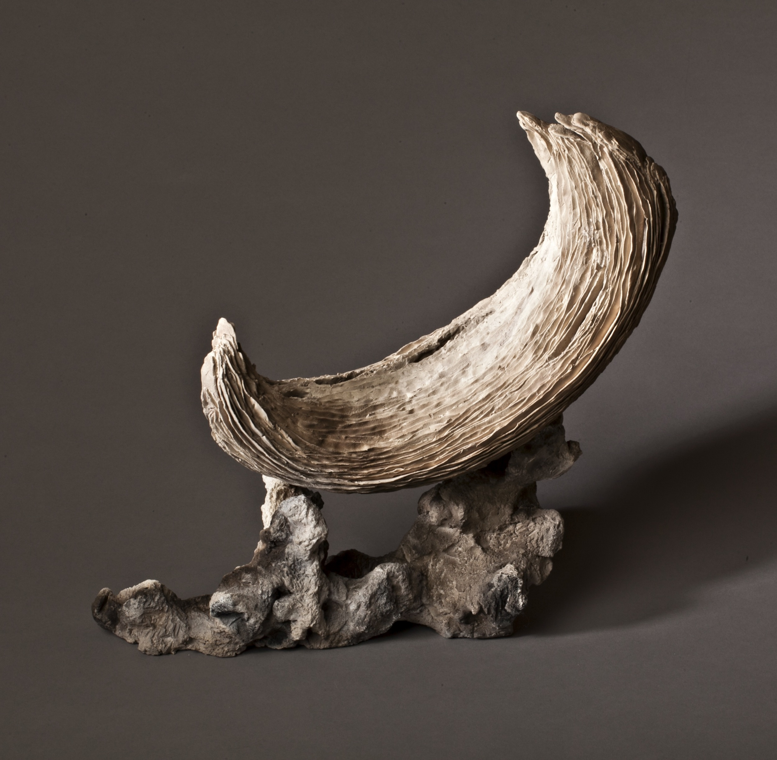 "Serene Crescent    2012    clay, kiln- and pit-fired    variable,  c. 12""h. x 6"" x 12"""