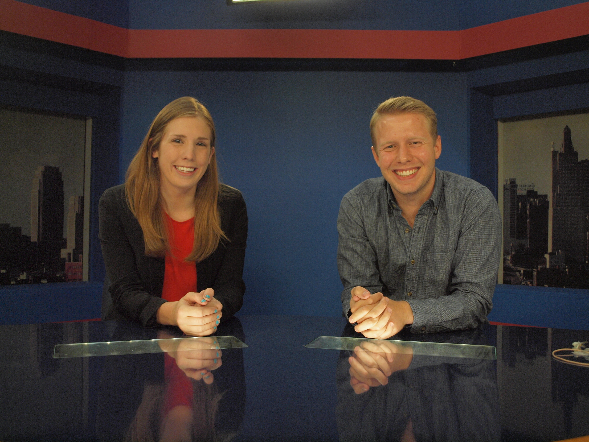 Seniors Cailey Taylor and Harrison Drake on the KUJH-TV set.