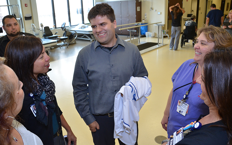 Andy Marso (center) visits with KU Hospital staff.