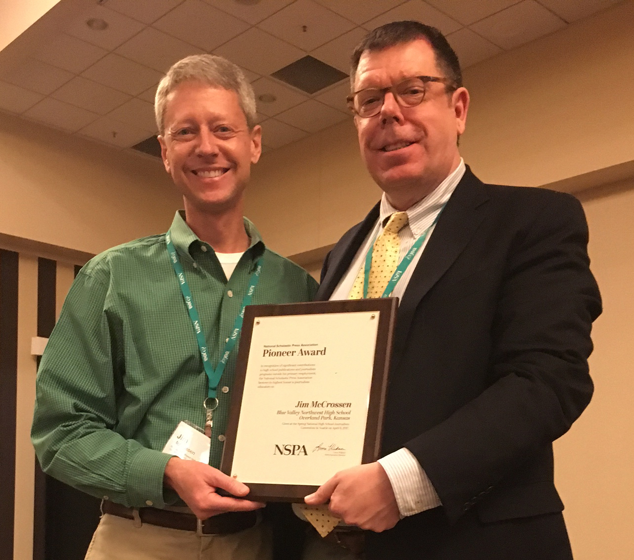 Jim McCrossen  (j'84) was awarded the National Scholastic Press Association Pioneer Award at the Journalism Education Association. McCrossen, the longtime teacher and adviser at Blue Valley Northwest High School, was honored for his long tenure of advising and service to the Kansas Scholastic Press Association board and summer workshops, including KU's summer journalism workshop.
