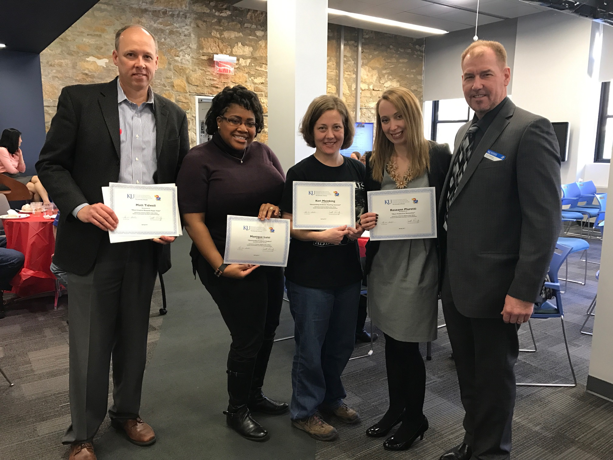 J-School graduate students were recognized April 3-7 during Graduate Student Appreciation Week, and the following students won awards: (from left)  Matt Tidwell, Monique Luisi, Keri Meinking  and  Roseann Pluretti  with Associate Dean  Scott Reinardy . Not pictured:  Husain Ebrahim