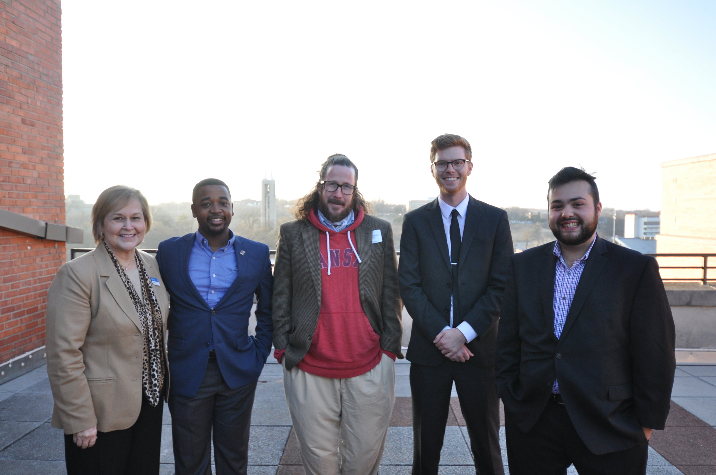 Dean Ann Brill with (from left) Joshua Robinson, Dan McCarthy, Sam Eastes and Juan Pablo Marroquin.