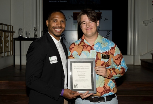 Christian Hardy accepts the Jim Murray Memorial scholarship in Arcadia, California, alongside University of Kansas alumnus Lubbock Smith III.