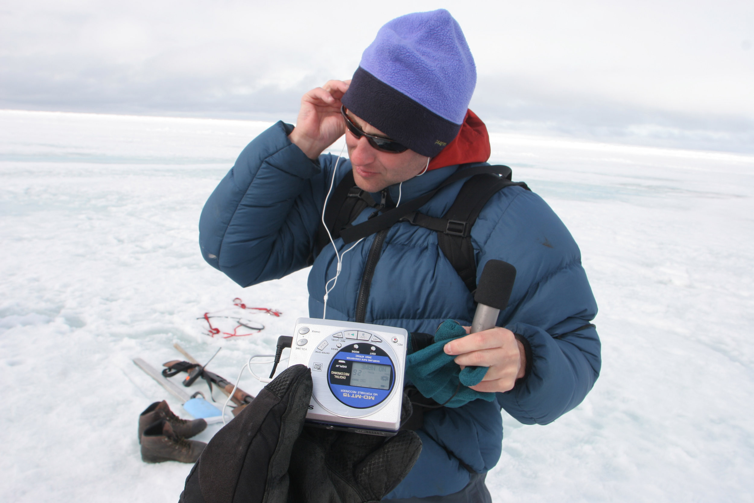 Craig Welch prepares to interview scientists at the edge of the frozen Arctic Ocean outside Barrow, Alaska. (Photo by Steve Ringman, The Seattle Times)