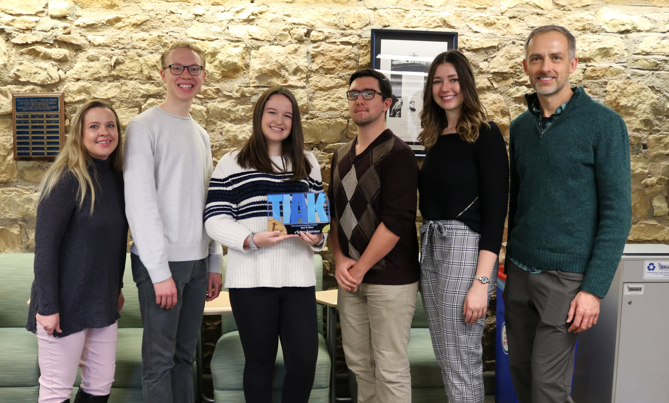 Students from JOUR 302 were presented with the Travel Industry Association of Kansas Marketing award. From left: Andrea Johnson (Director of Marketing & Communications, Unmistakably Lawrence), Grant Heiman, Jordan Arnold, Brock Sauvage, Grace Woods and Associate Professor Peter Bobkowski