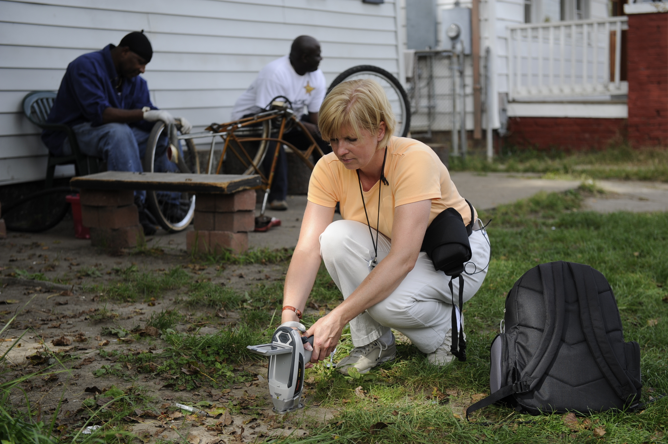 As an investigative reporter for USA Today, Alison Young spent weeks on the road testing soil with a handheld X-ray device in neighborhoods around long-closed lead smelters as part of her Ghost Factories investigation. (Photo courtesy of USA Today)