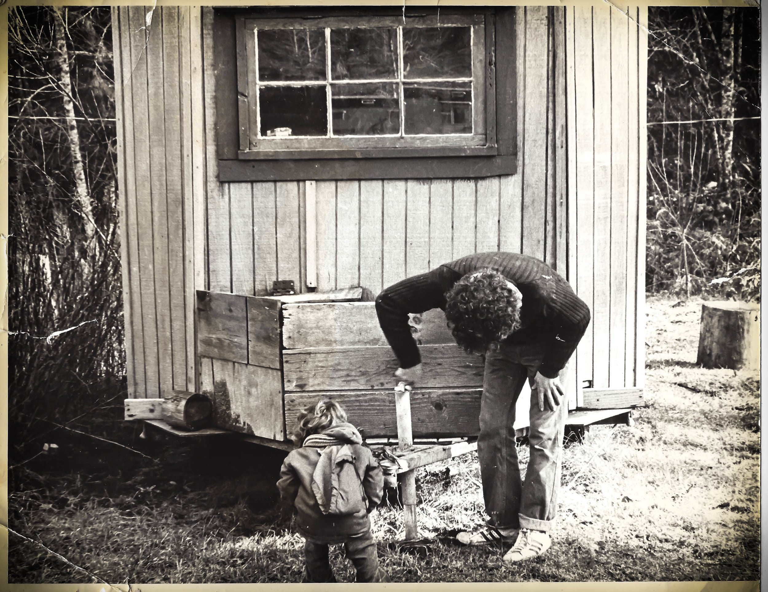 Jon and 3 year old Jen adjusting the first tiny house in 1978