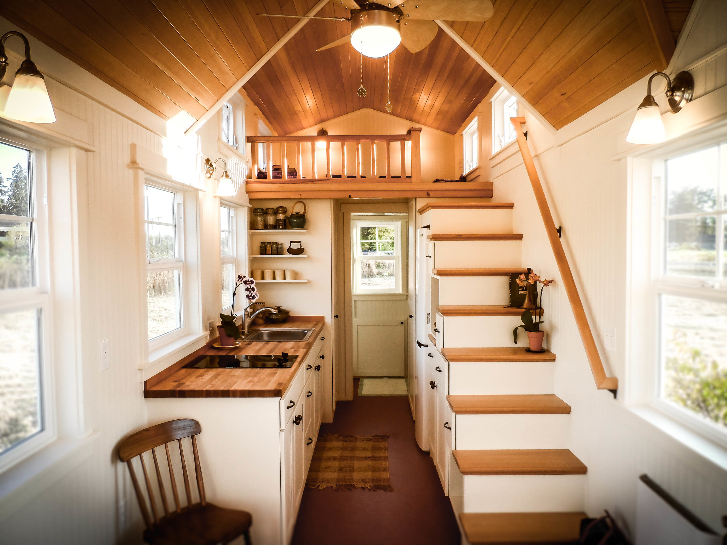 tiny house with loft bedroom and ladder