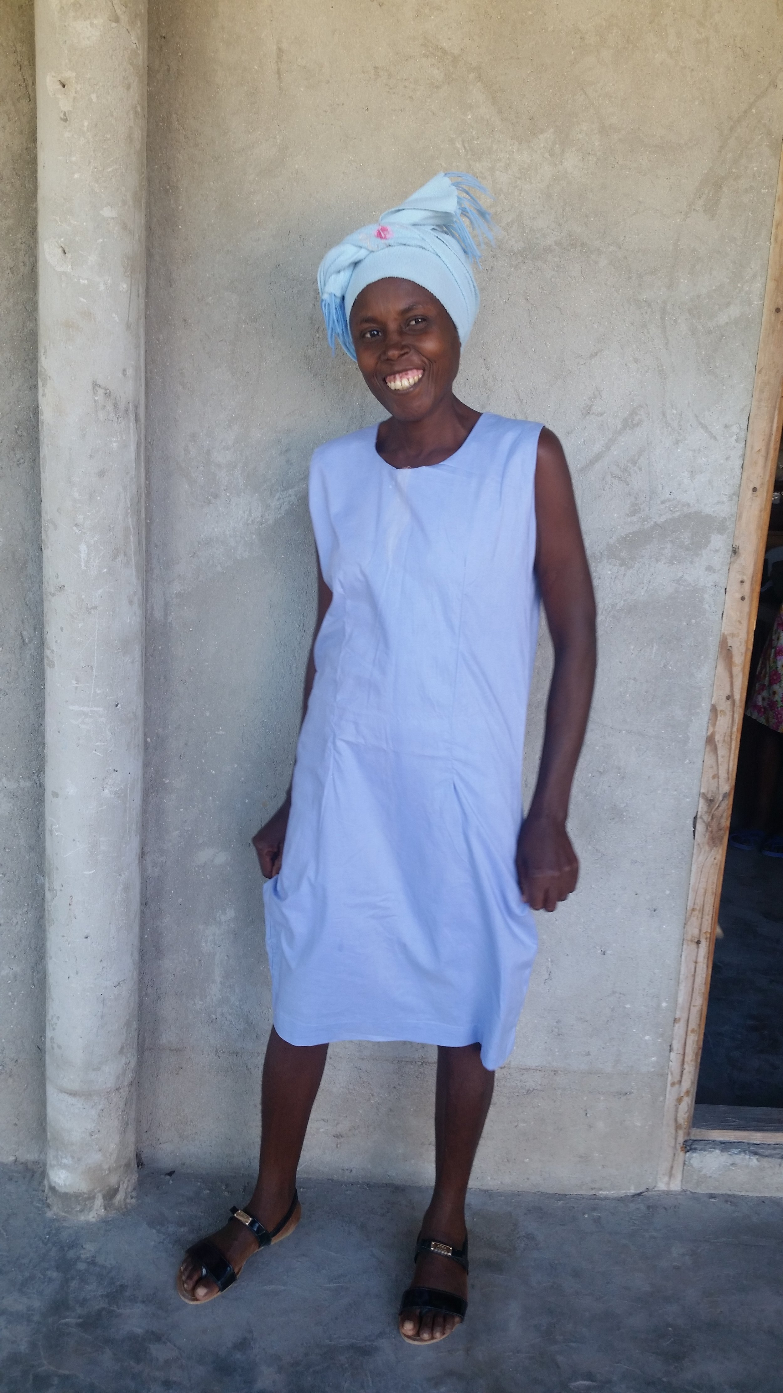 Sonia, a student in our Mole St. Nicolas class, models a new dress she made.
