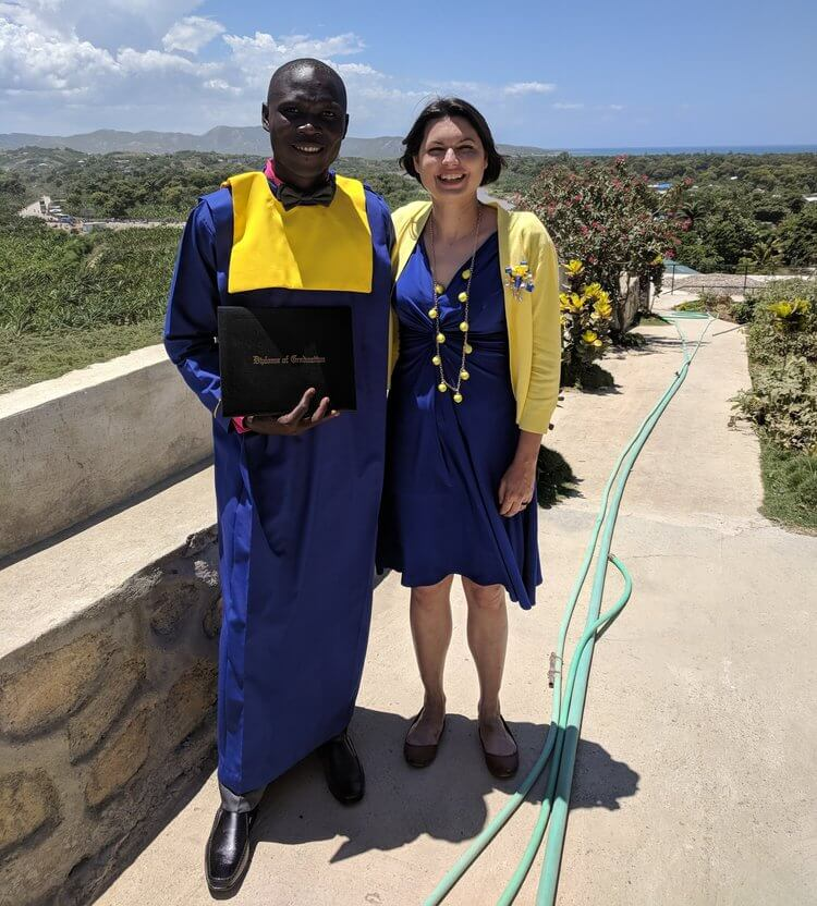 Michelle with Daryl, a graduate of the Port-de-Paix sewing program, at the 2018 graduation.