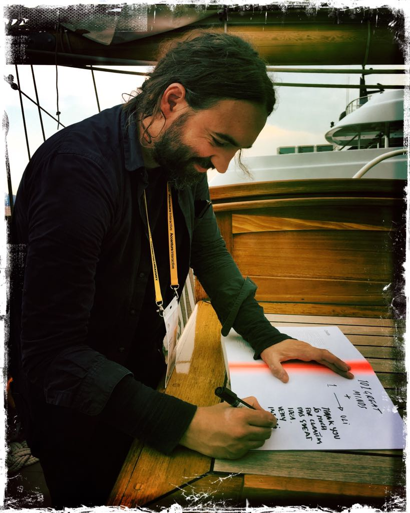 "Ferdinando signing his copy of ""101 Great Minds on Music, Brands and Behavior"""