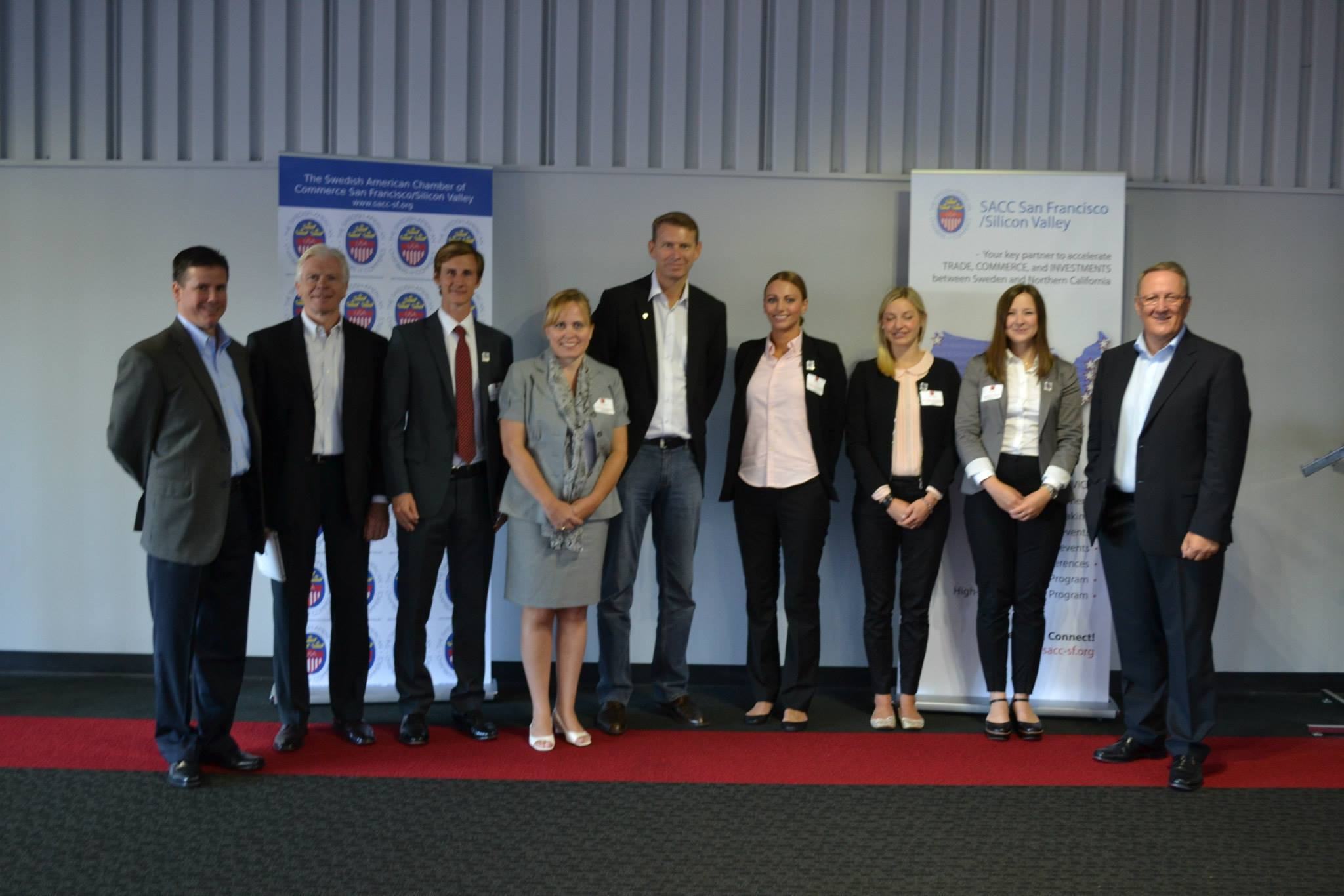 Charlotte Danielsson with Tesla employees and SKF CEO