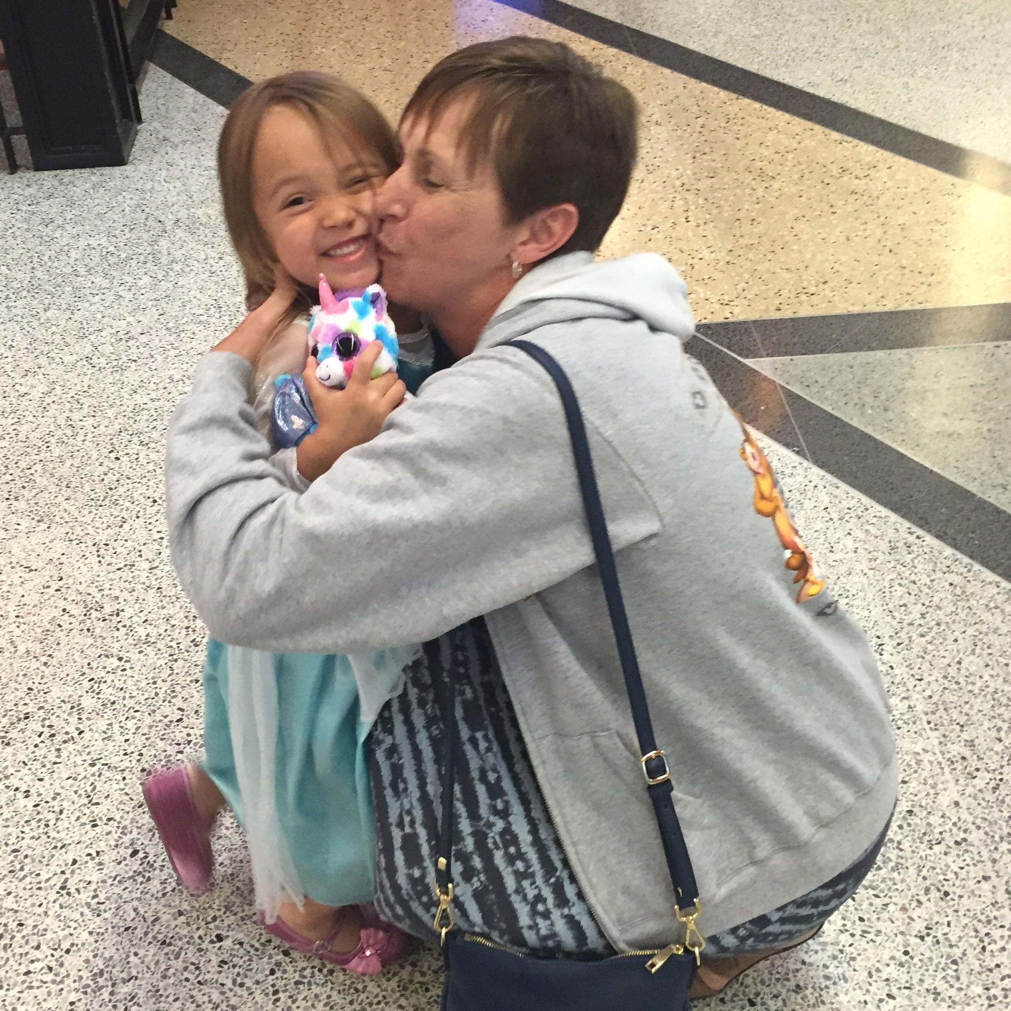 Kisses for Grammy before she leaves!
