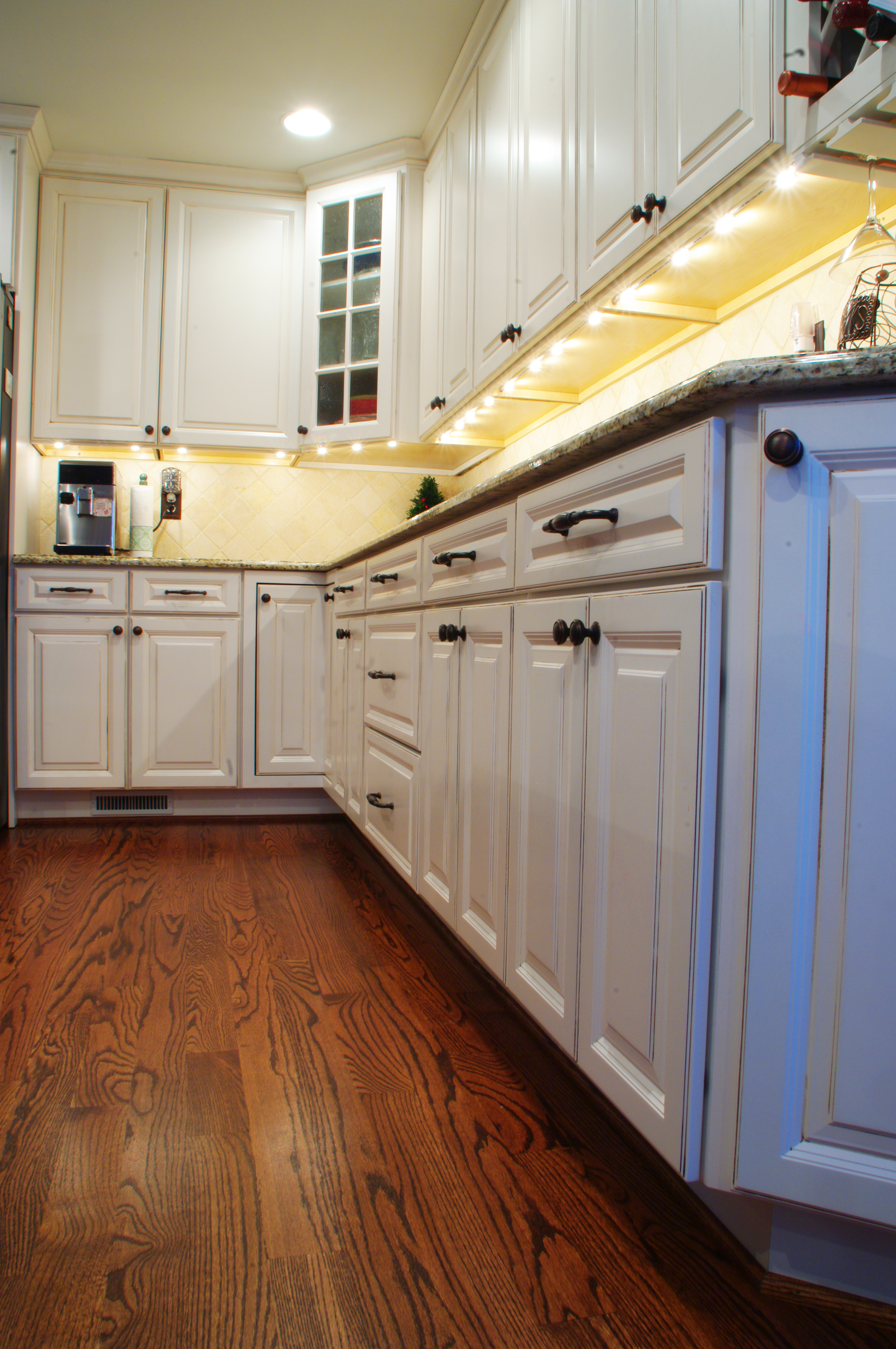 Beautiful contrast of the light cabinetry with the dark oak flooring.
