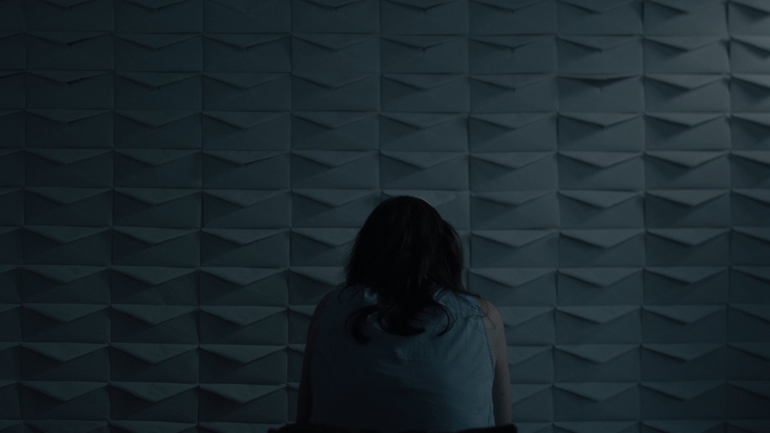 So this is my official favorite shot of the movie. A dolly shot starting from back moving in on her as she is fighting the pain of her recent wisdom teeth removal. The production designer did a great job with the envelopes, it really adds to the scene. I used an astra LED panel w/ opal to light the wall with two 2x3 flags cutting down on the spill and giving more of a strip of light. On her I used the Lit Mat w/ full grid and the egg crate to make her pop a little more.