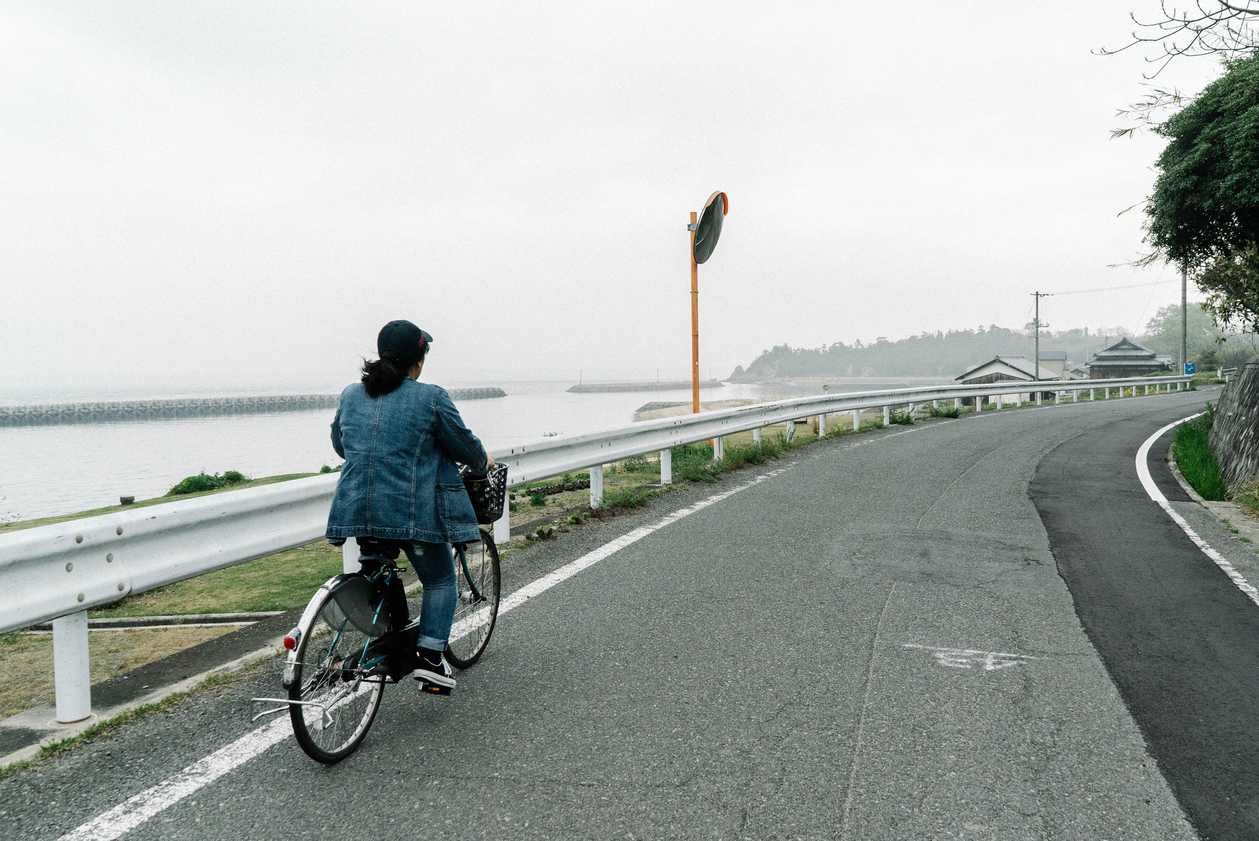 cycling through the local streets of Teshima