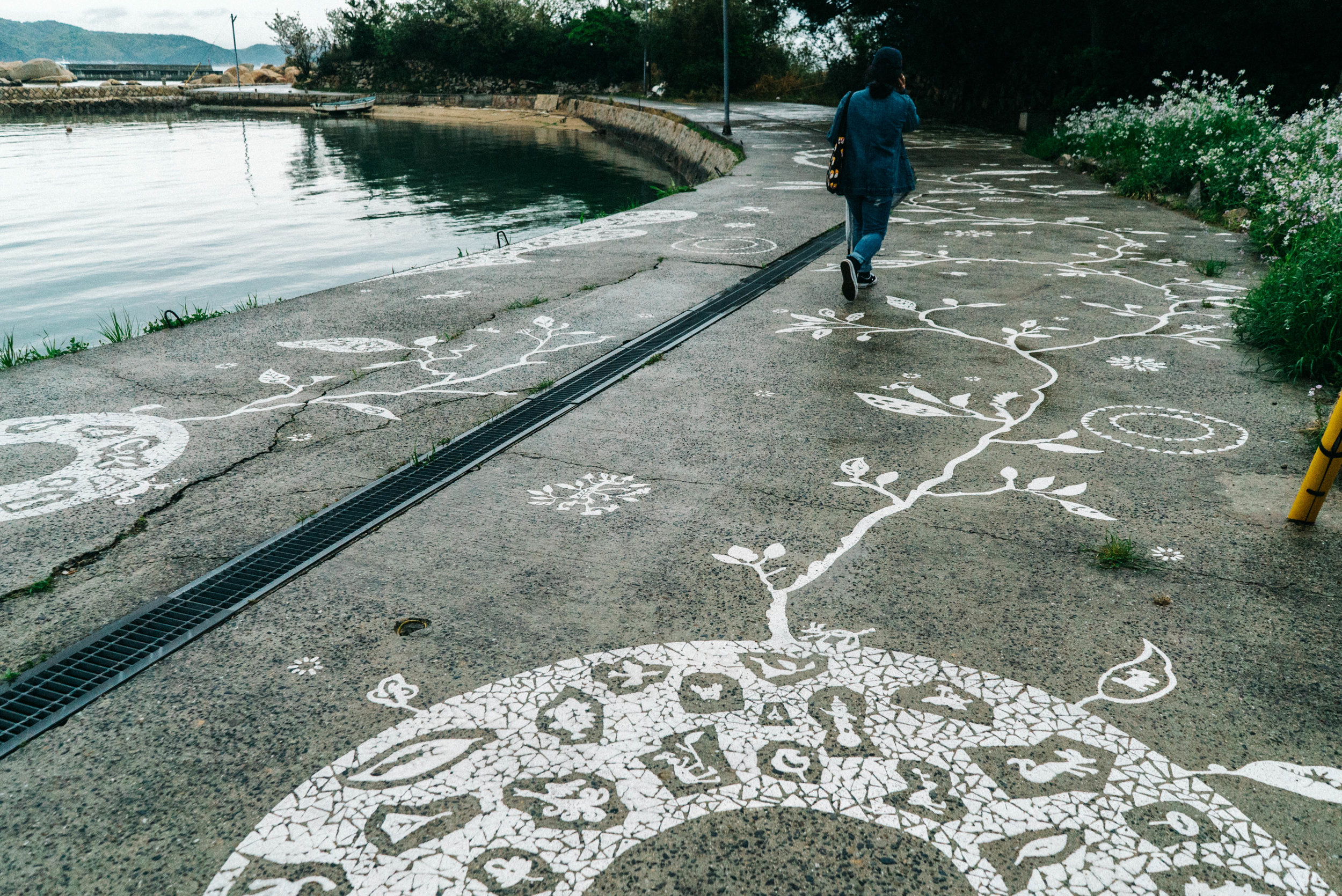 art along the pavement near Inujima port
