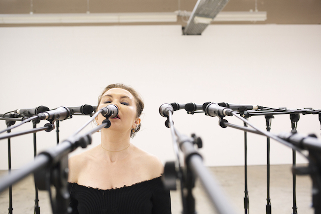 "Fielded performing vocals in New York-based visual artist Naama Tsabar's ""Transition #4""  (an orchestra of sonic sculptures)  at Kunsthaus Baselland, June 2018. Photo by Carmen Wong Fisch."