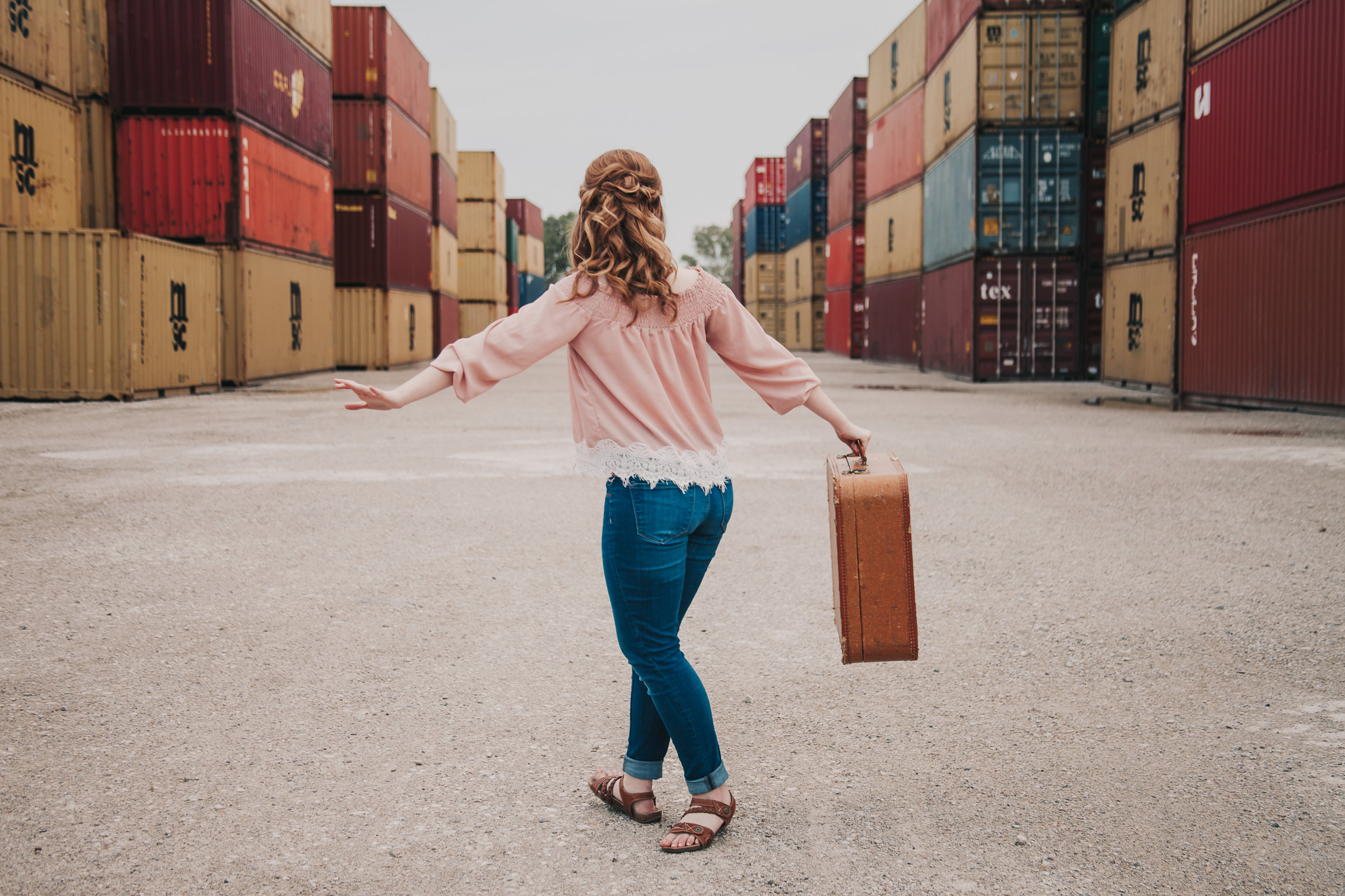 Kansas City Senior Photography with Shipping Containers and Suitcase by Merry Ohler
