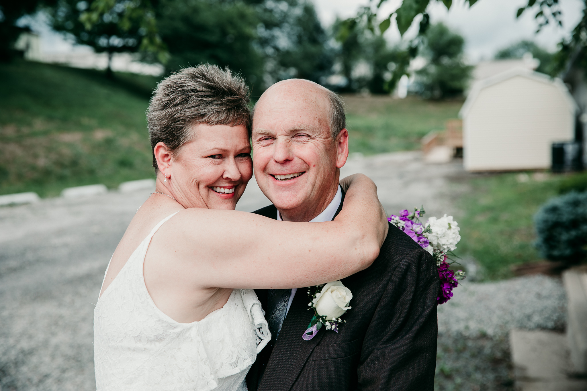 Bride and groom smile and embrace. © Merry Ohler Creative, 2019. Photo by Merry Ohler, who is the best wedding photographer in Kansas City.