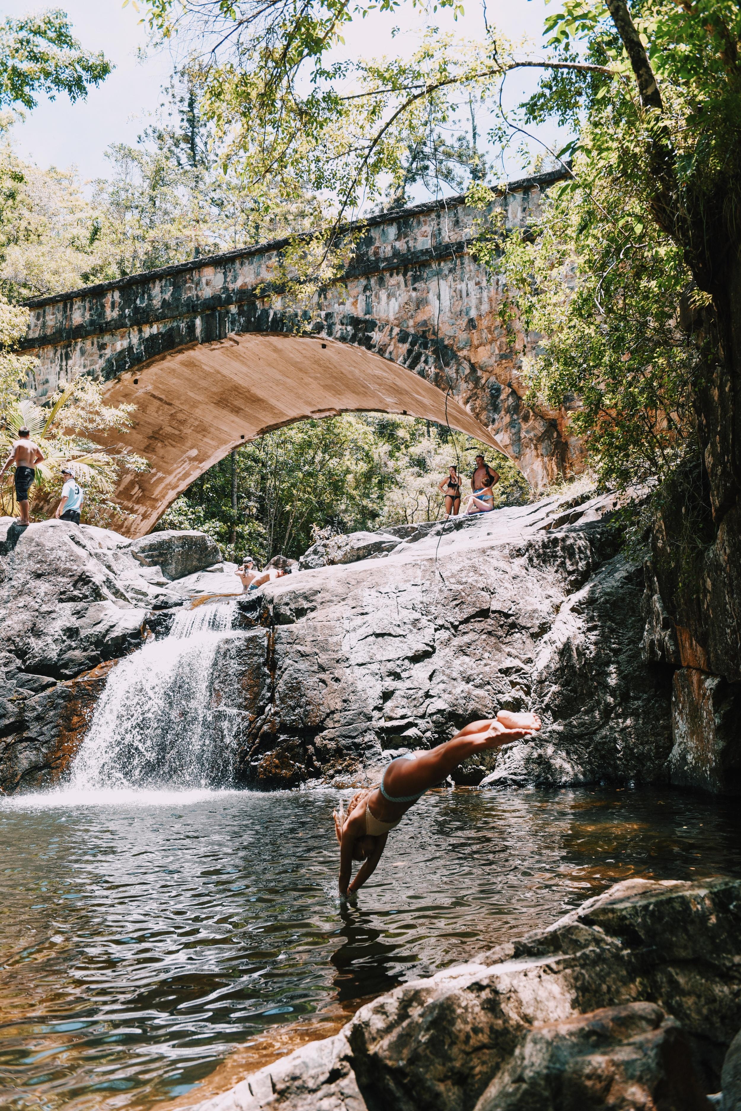 Diving into fresh water at Crystal Creek falls