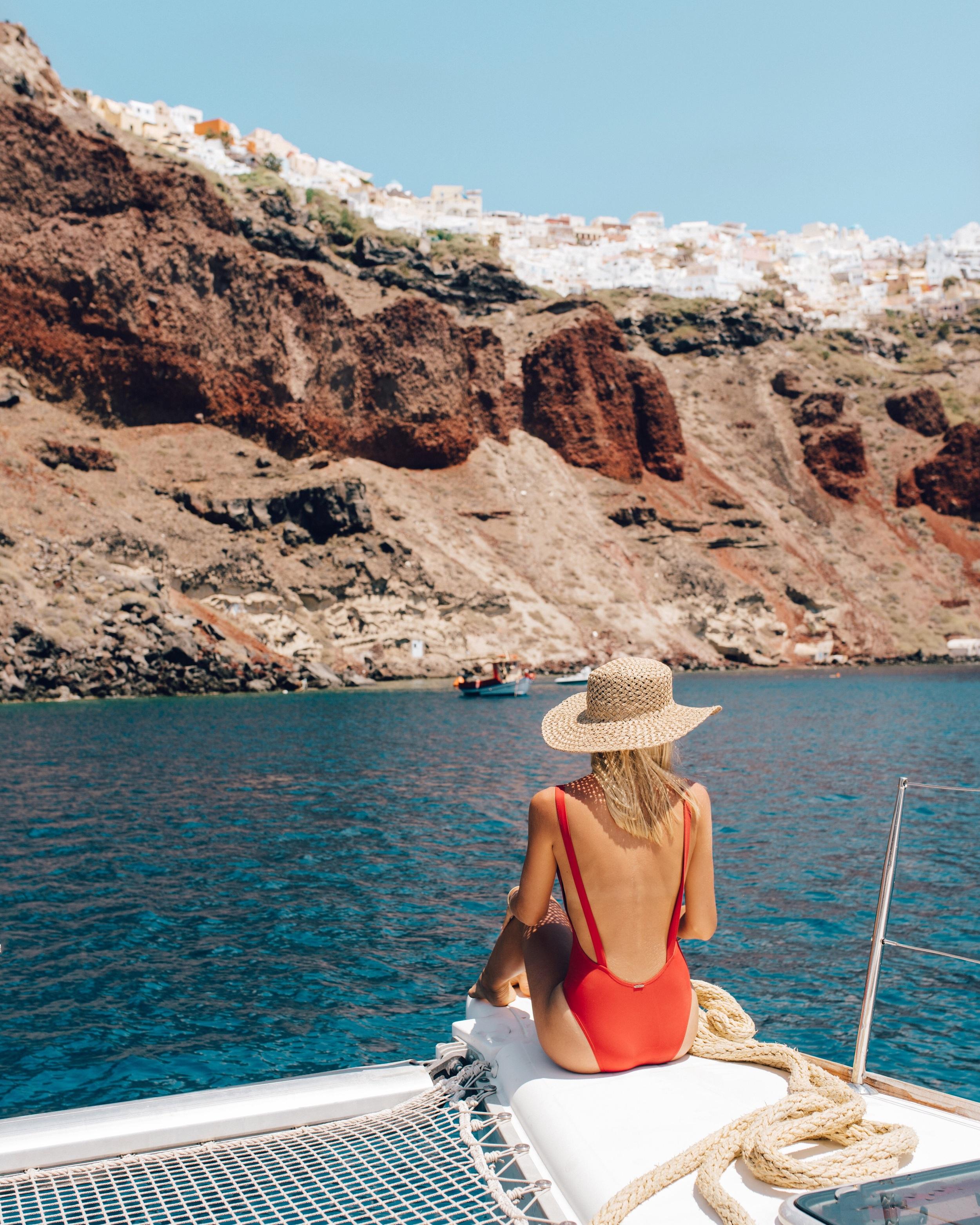 Sailing around Santorini. Bikini: mime swim