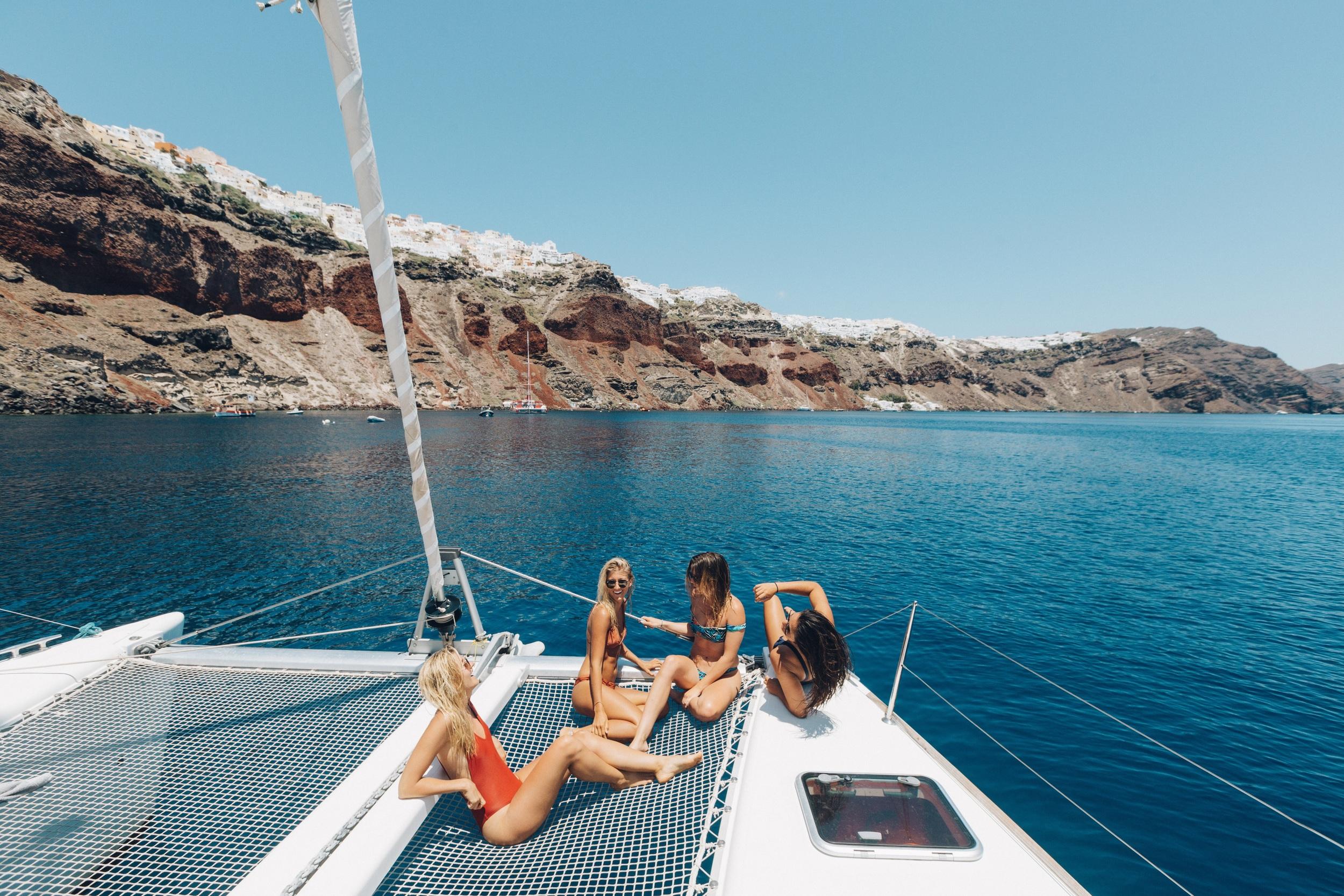Sailing around Santorini with my fav gals