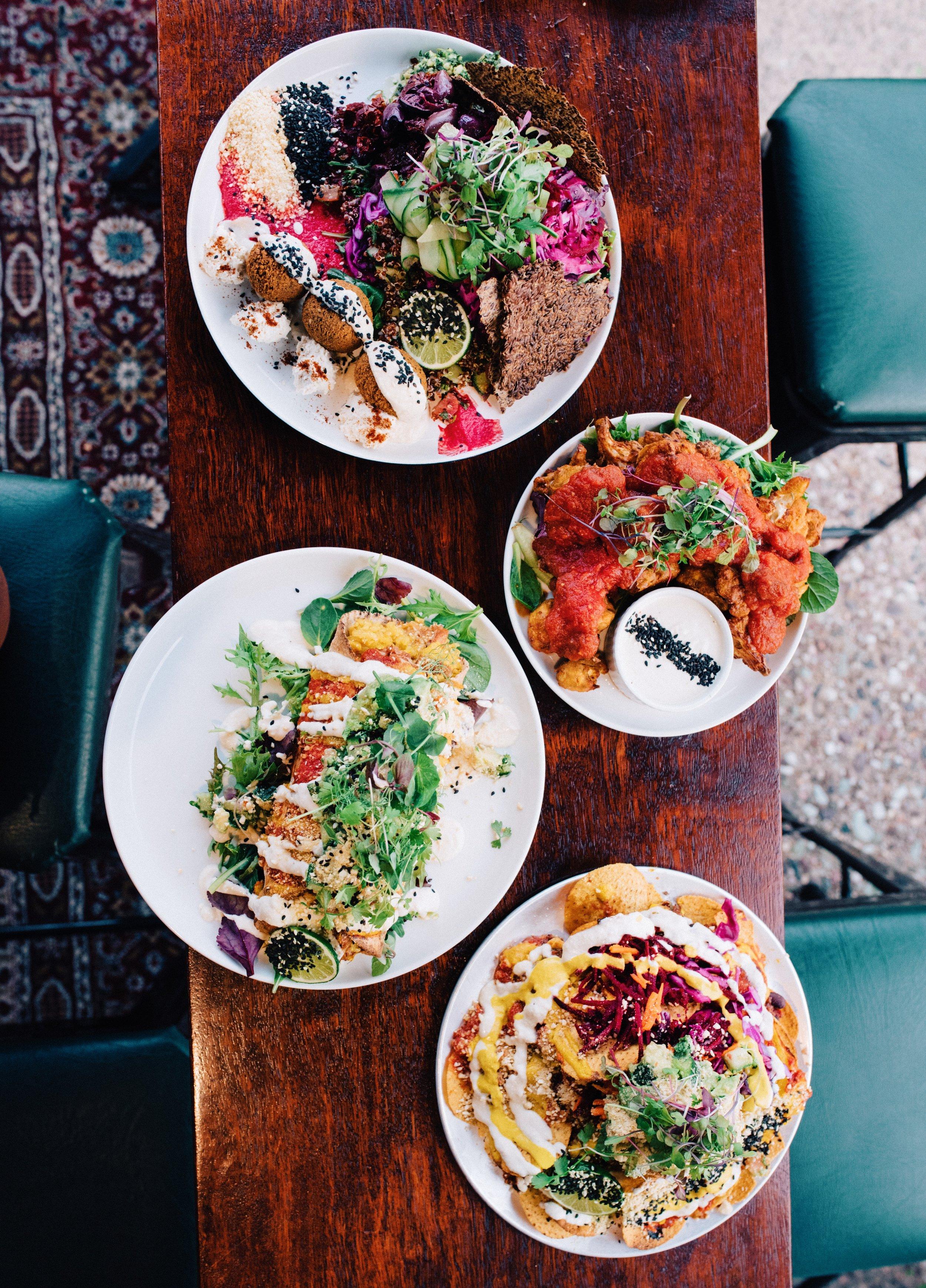 Top to bottom: planet plate, cauliflower wings, enchilada, nachos