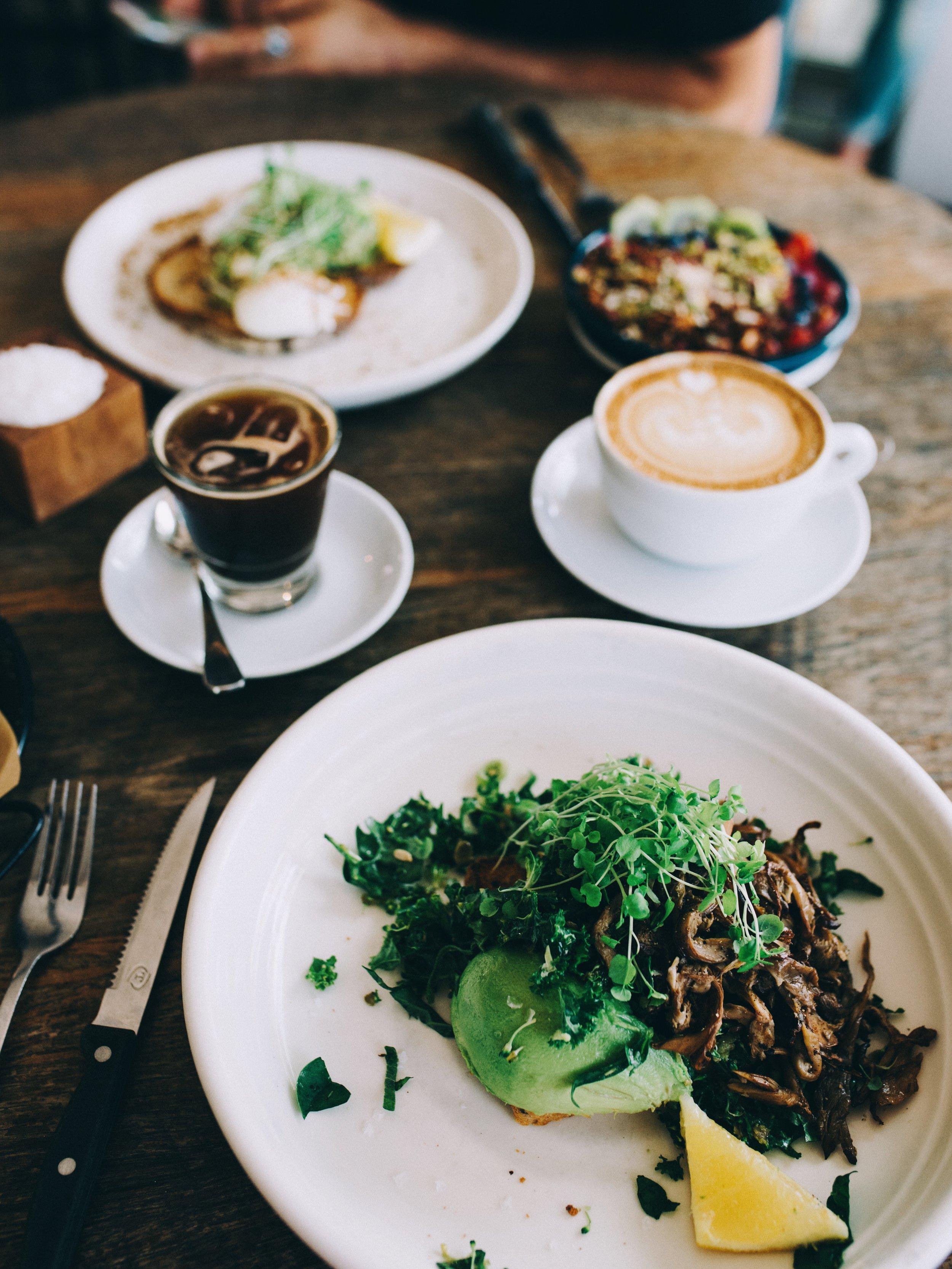 Avocado, greens, wild mushrooms on GF toast