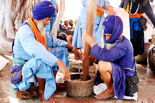 Nihangs preparing Sukhnidhaan, a Bhaang infused drink.
