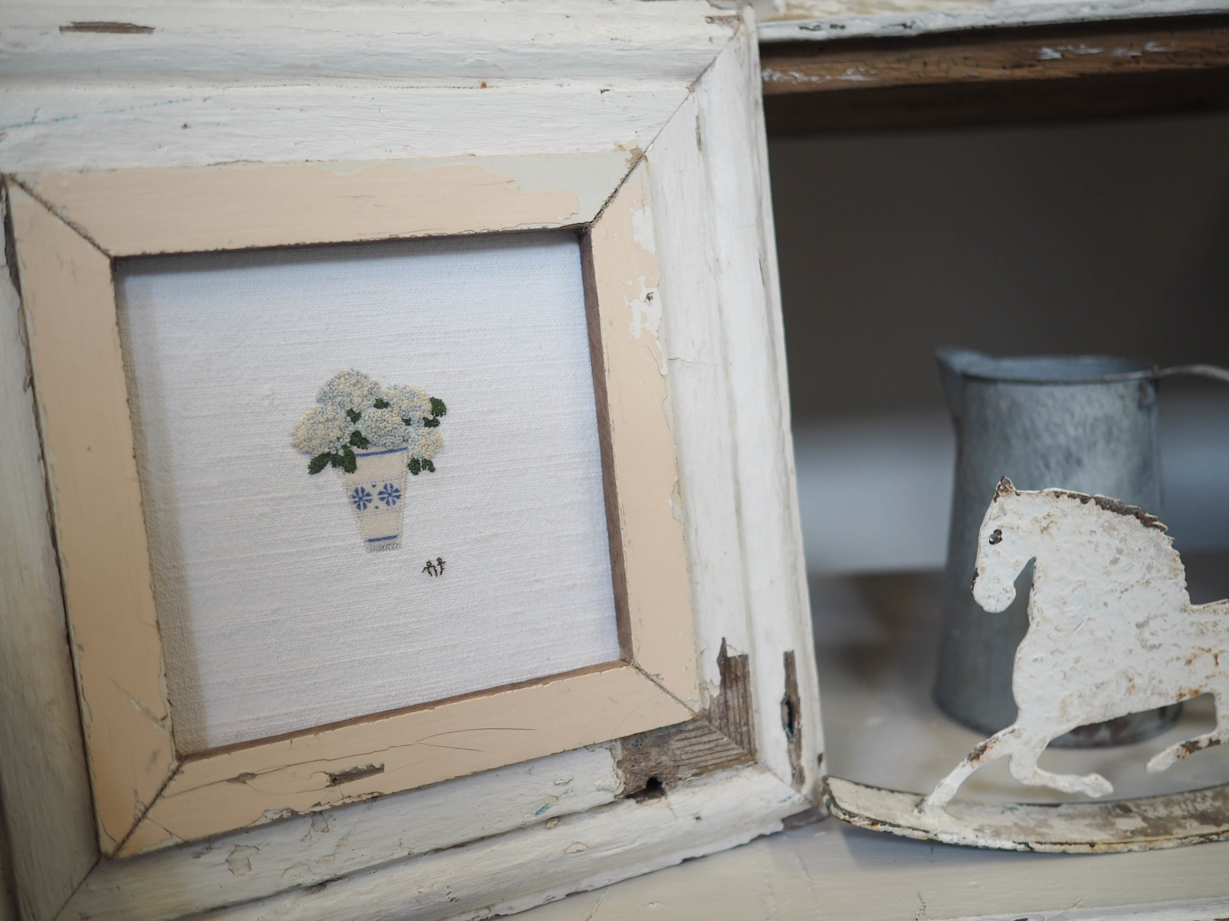 Blue hydrangea in handmade chippy frame.