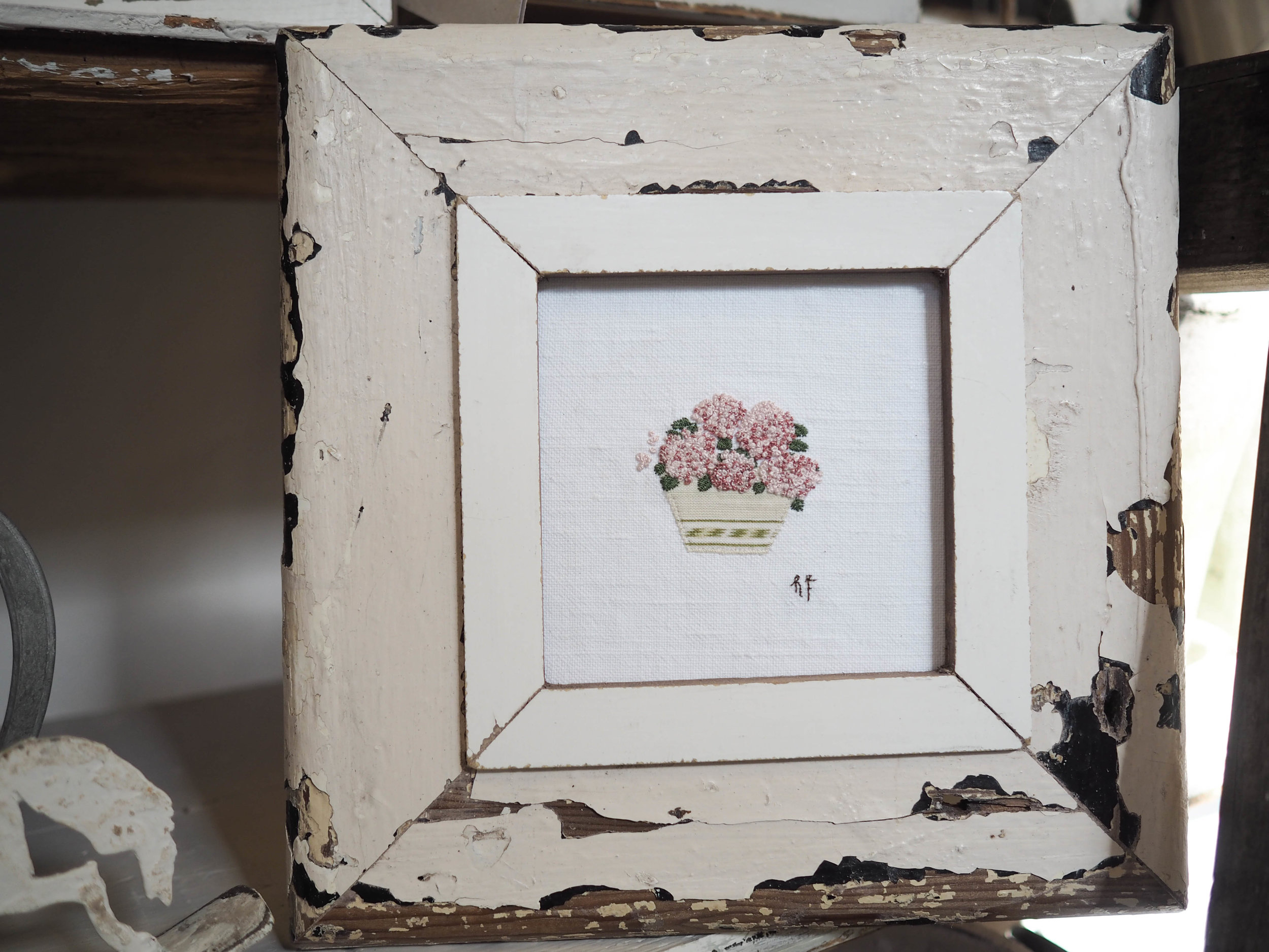 Pink hydrangea embroidery in handmade chippy frame.