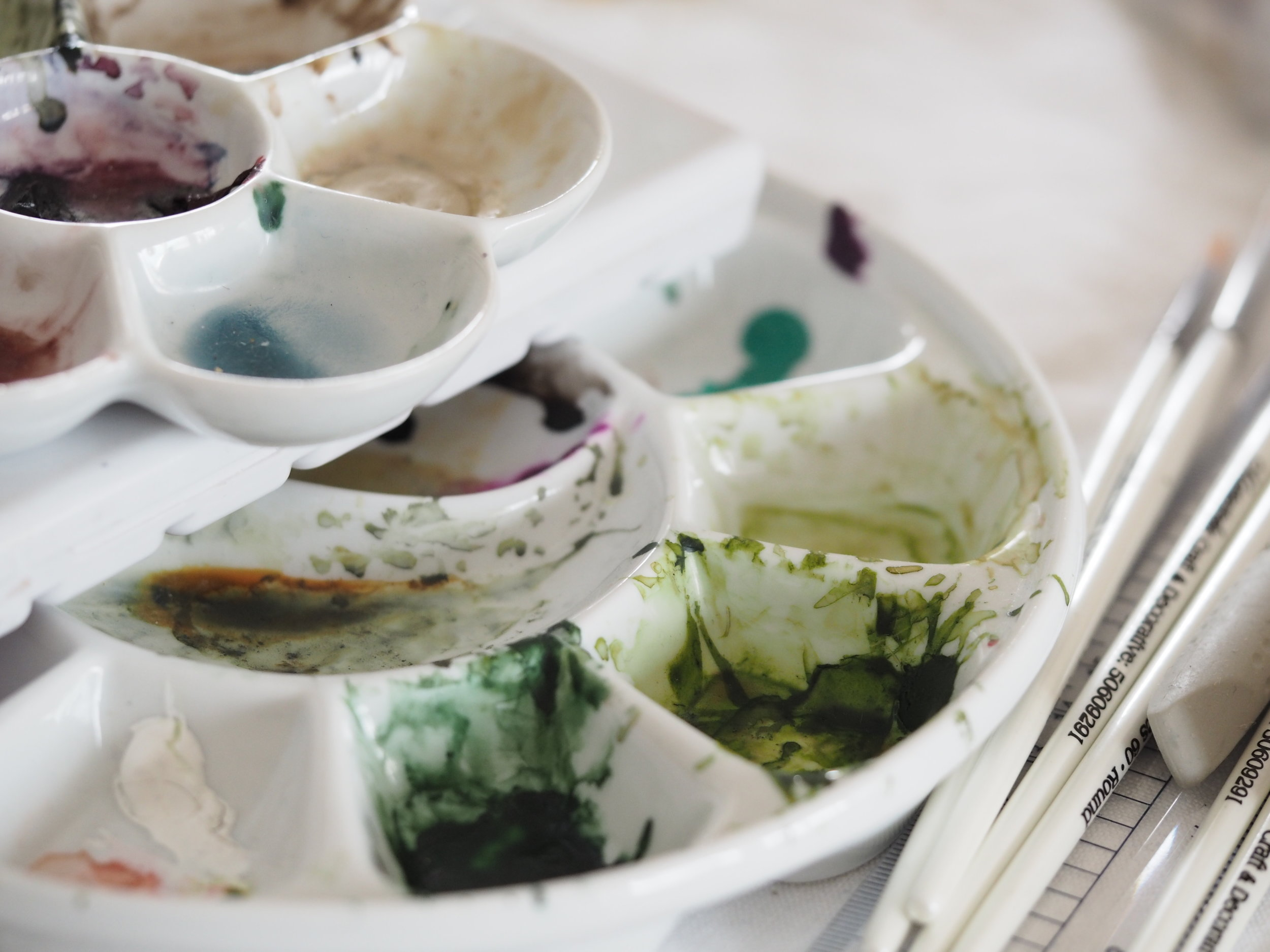 Watercolours in ceramic palettes.