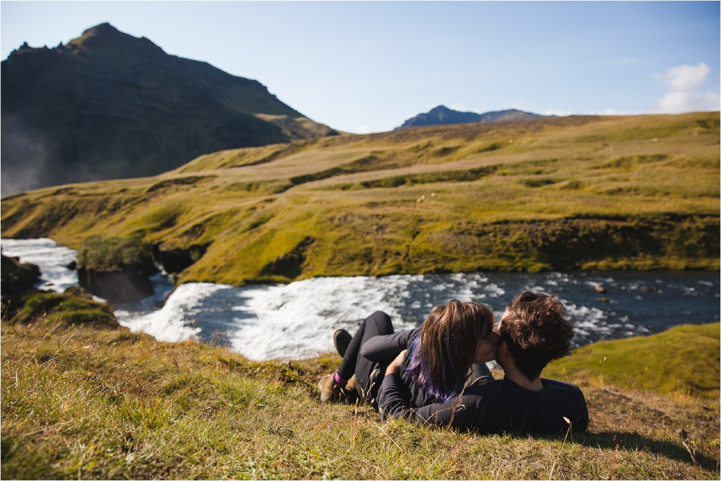 Iceland Vacation Summer, Elopement Photographer, Destination Wedding Photographer, Iceland Photographer, Iceland Elopement Photographer, Destination Wedding Photographer, Travel Wedding Photographer, Travelling Elopement Photographer, Danielle Salerno Photography, Skogafoss, Couple Laying in Grass