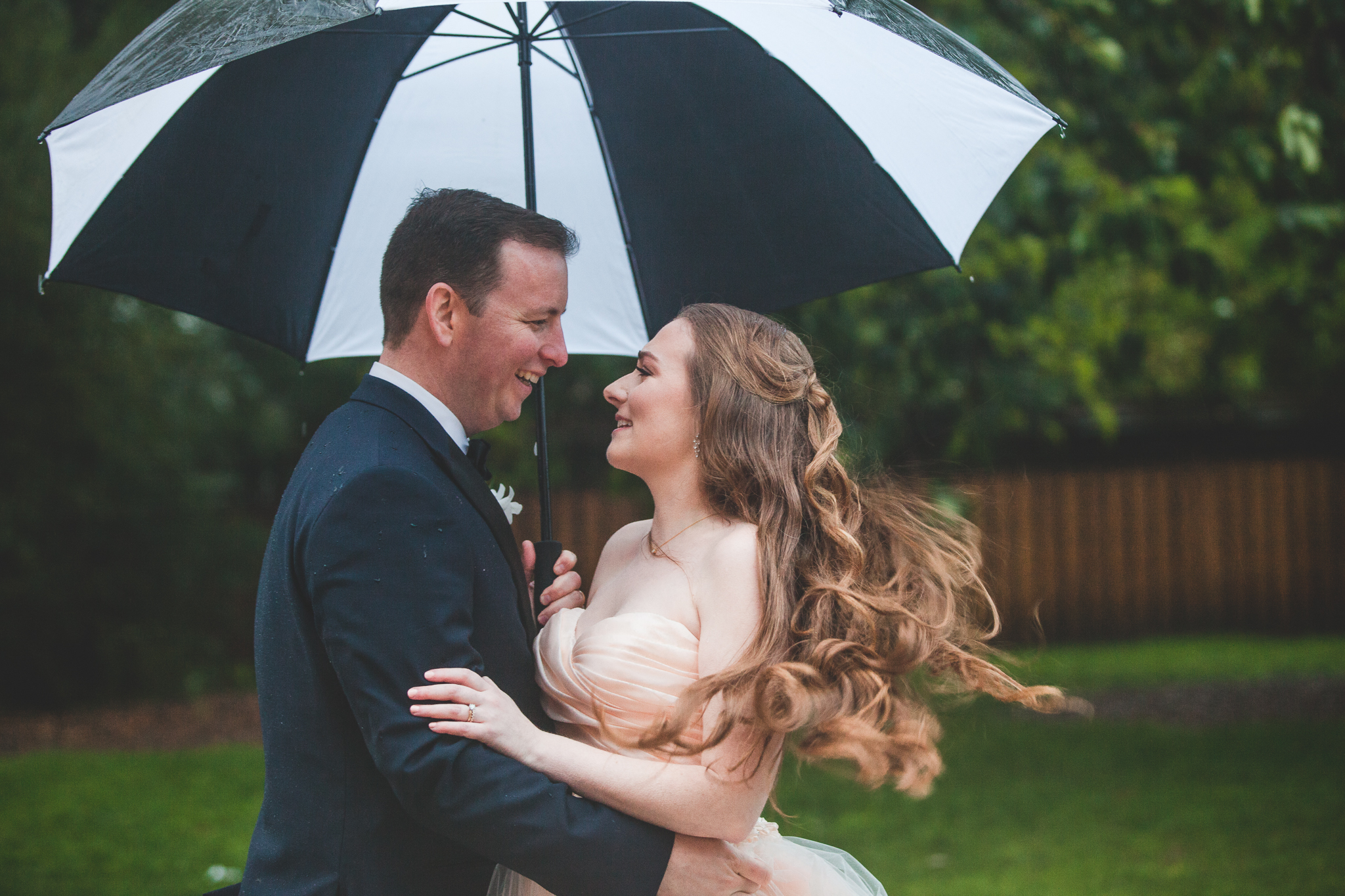 Sarah and Mark - She captured the most breathtaking pictures on our rainy wedding day that we will cherish forever. Every single step of the process from booking her to getting our pictures back has been so personalized.