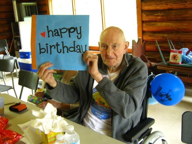 Gerry Alexander celebrating a birthday at Camp Maskepetoon