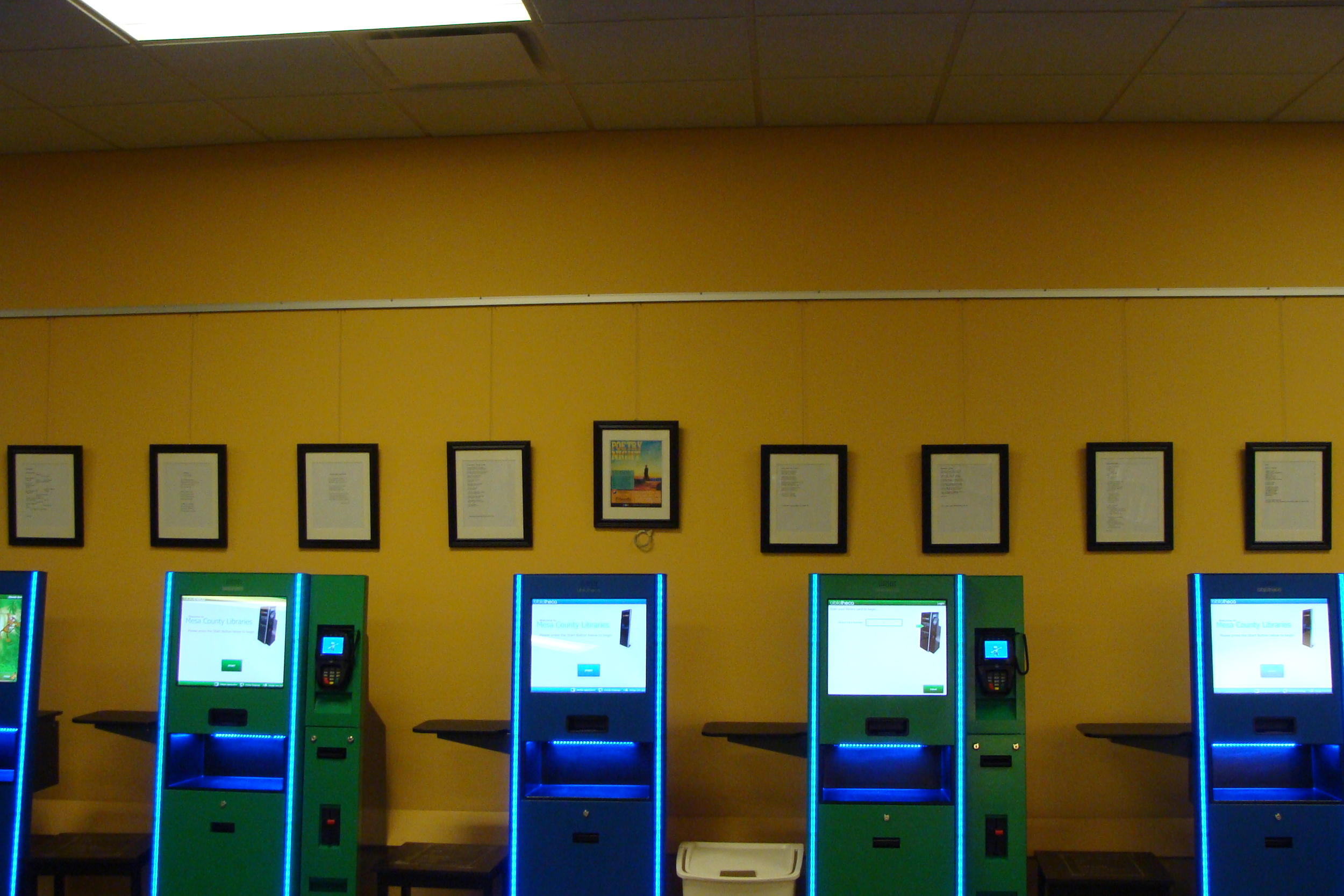 Poems above the check-out kiosks at Mesa County Public Library