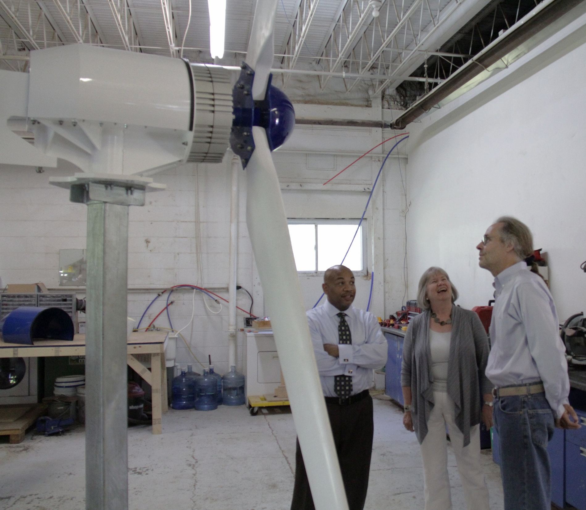Carl Heastie, D-Bronx, left, speaker of the NY State Assembly, and Assemblywoman Barbara Lifton, D-Ithaca, talk to Weaver Wind Energy president Art Weaver at an open house.