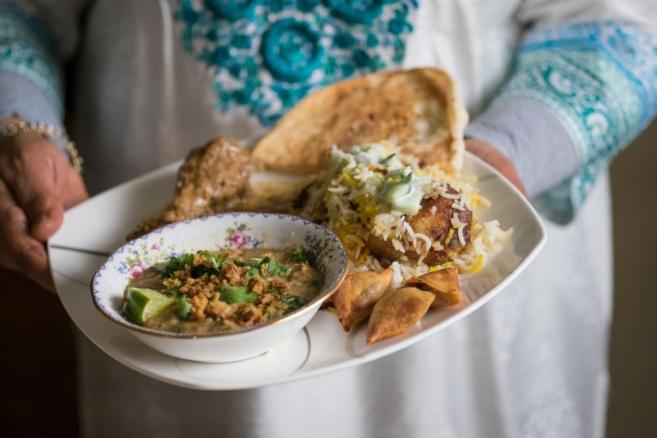 Savana holding EID food.jpg