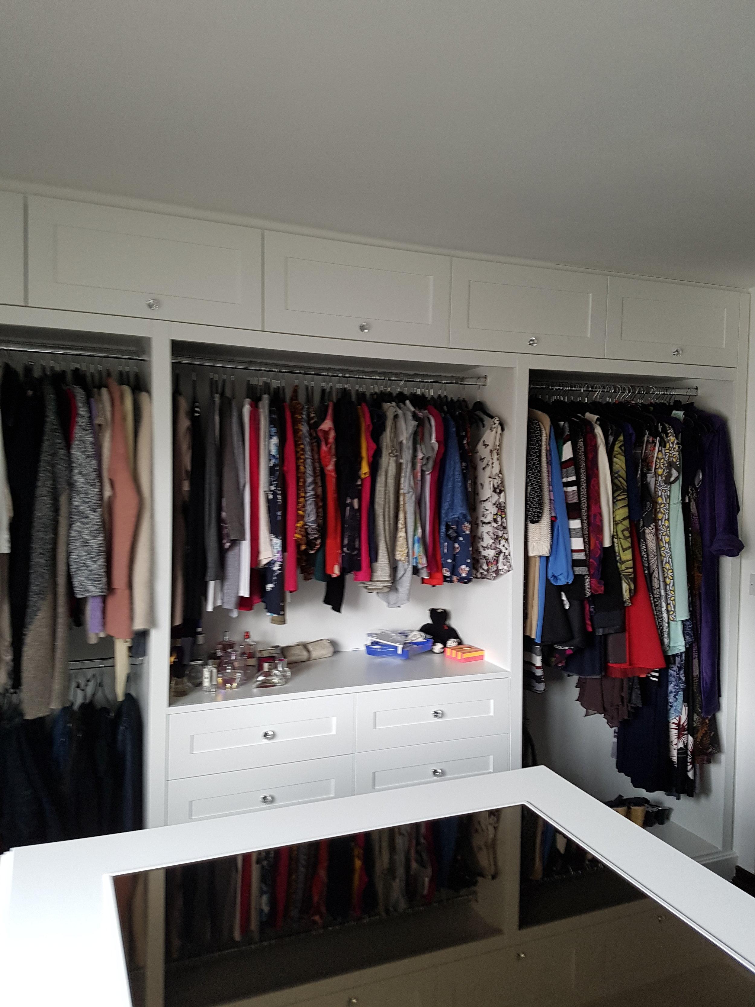 Walk in wardrobe hanging.jpg