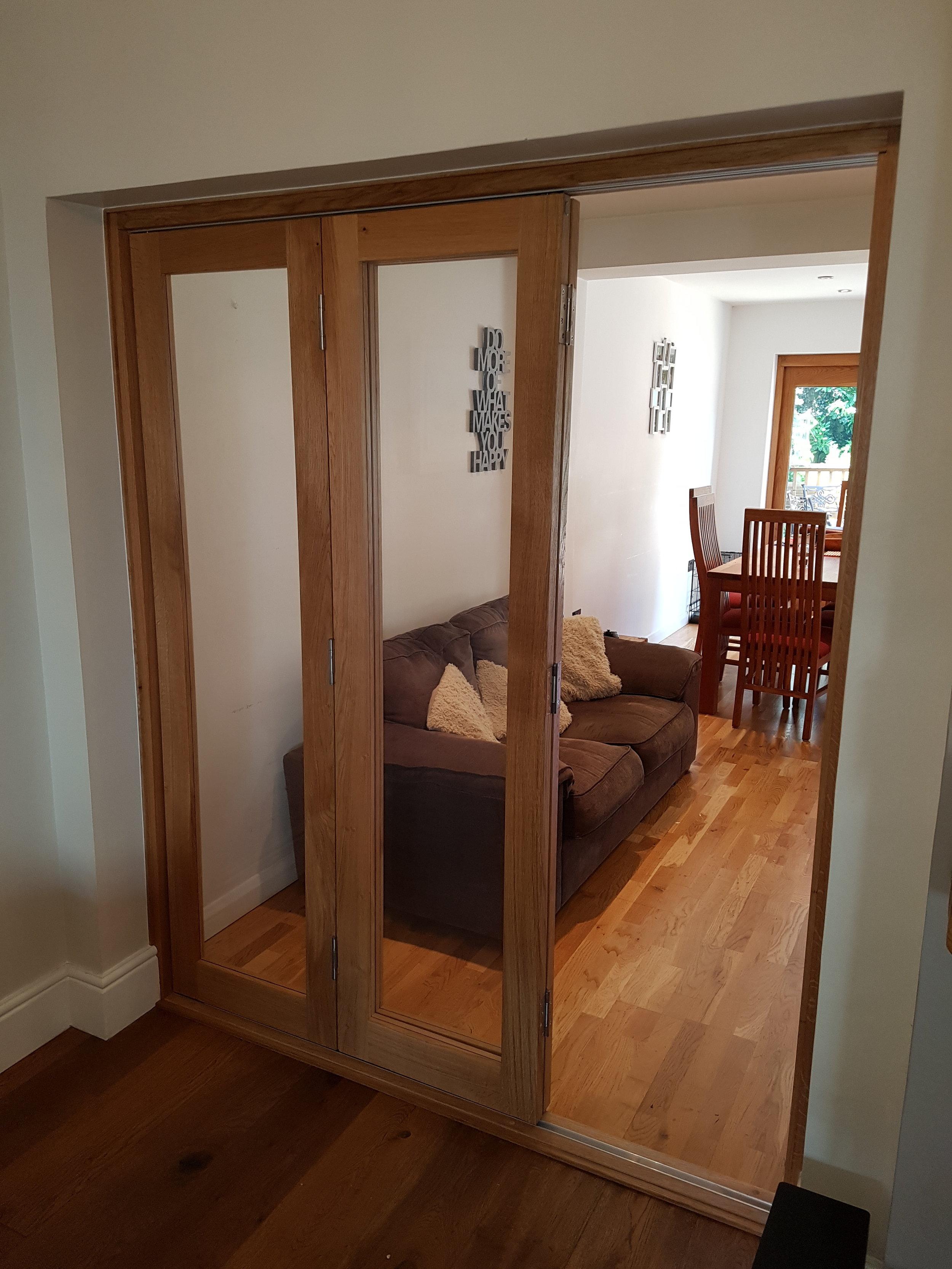 Oak bi-fold doors partial open.jpg