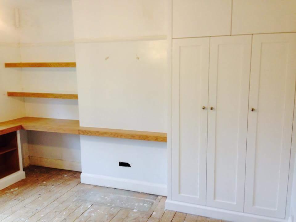 White spray finish wardrobe, chunky oak shelving.jpg