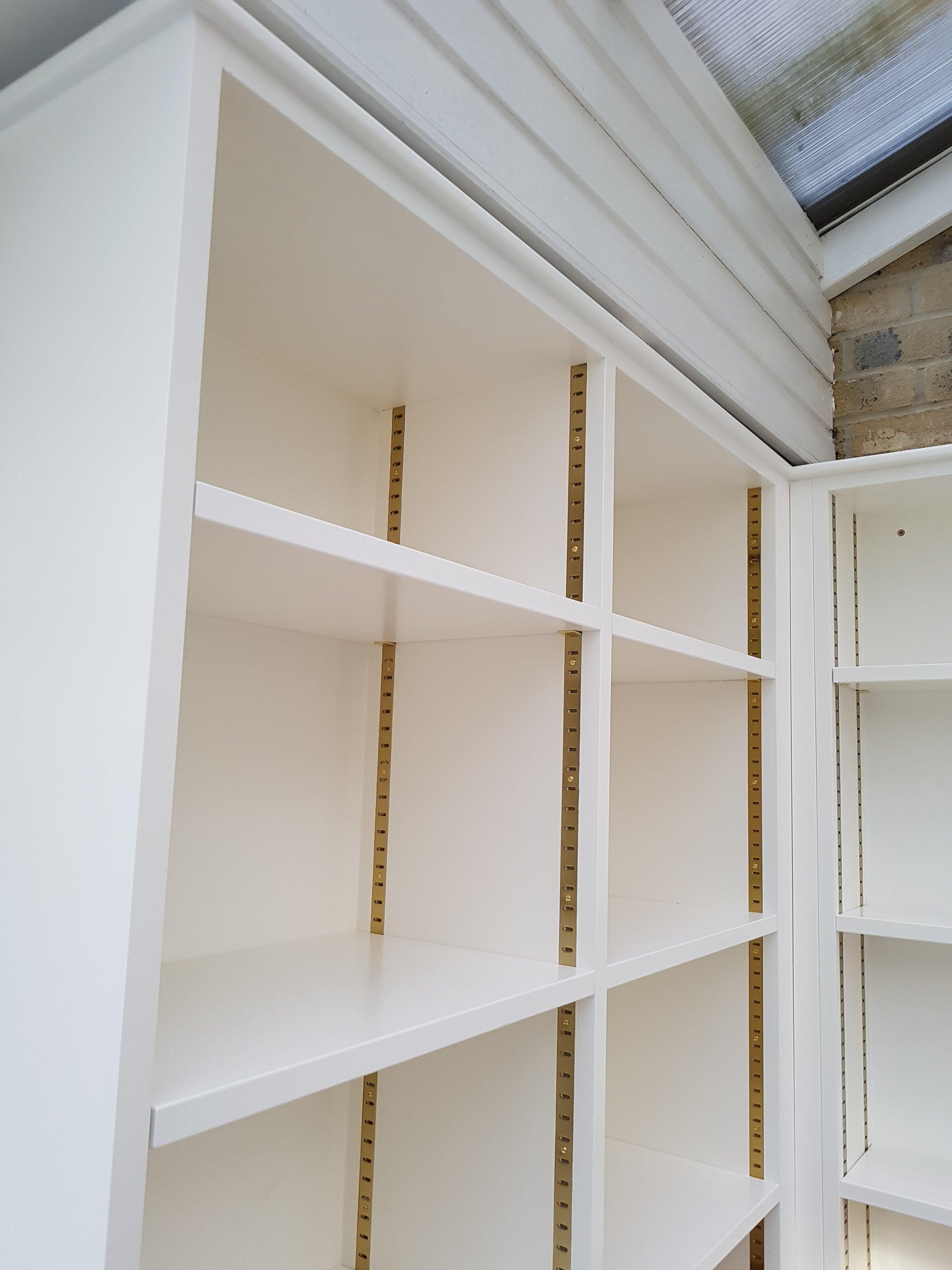 corner bookcase, adjustable shelving.jpg