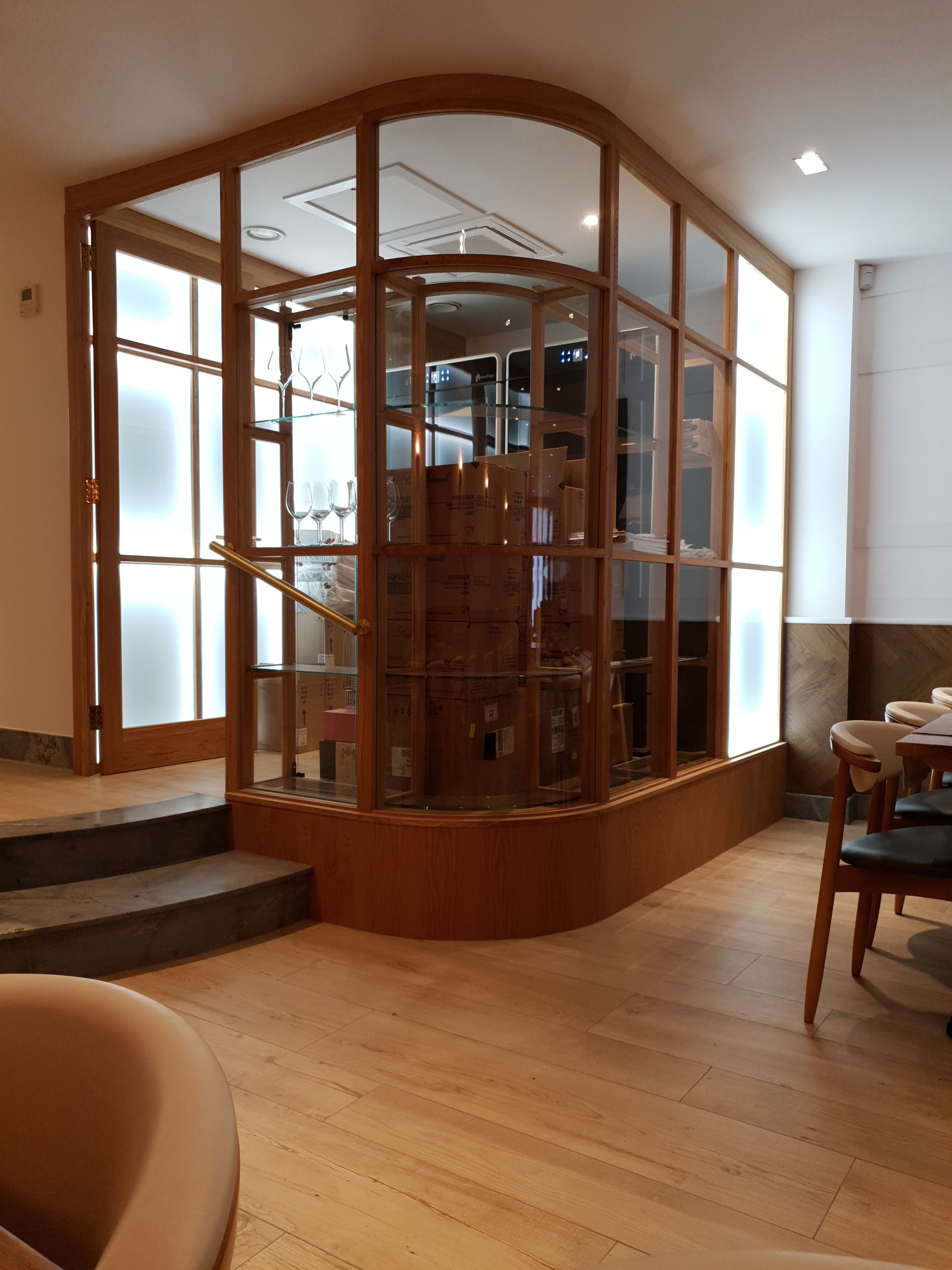 curved glass wine room.jpg