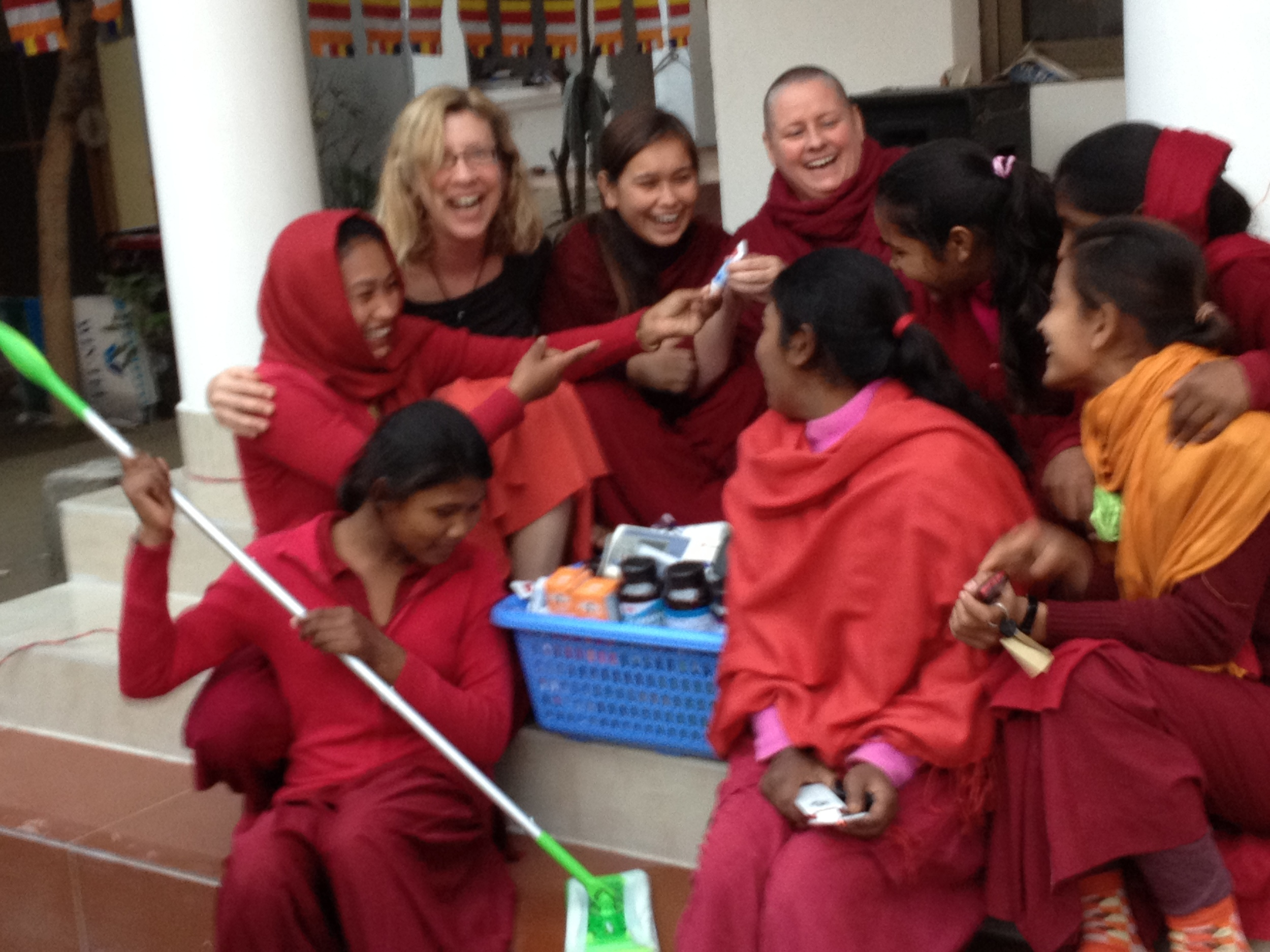Unpacking cleaning supplies for the Peace Grove Nunnery.  Never would have imagined how much joy those mops gave those girls!